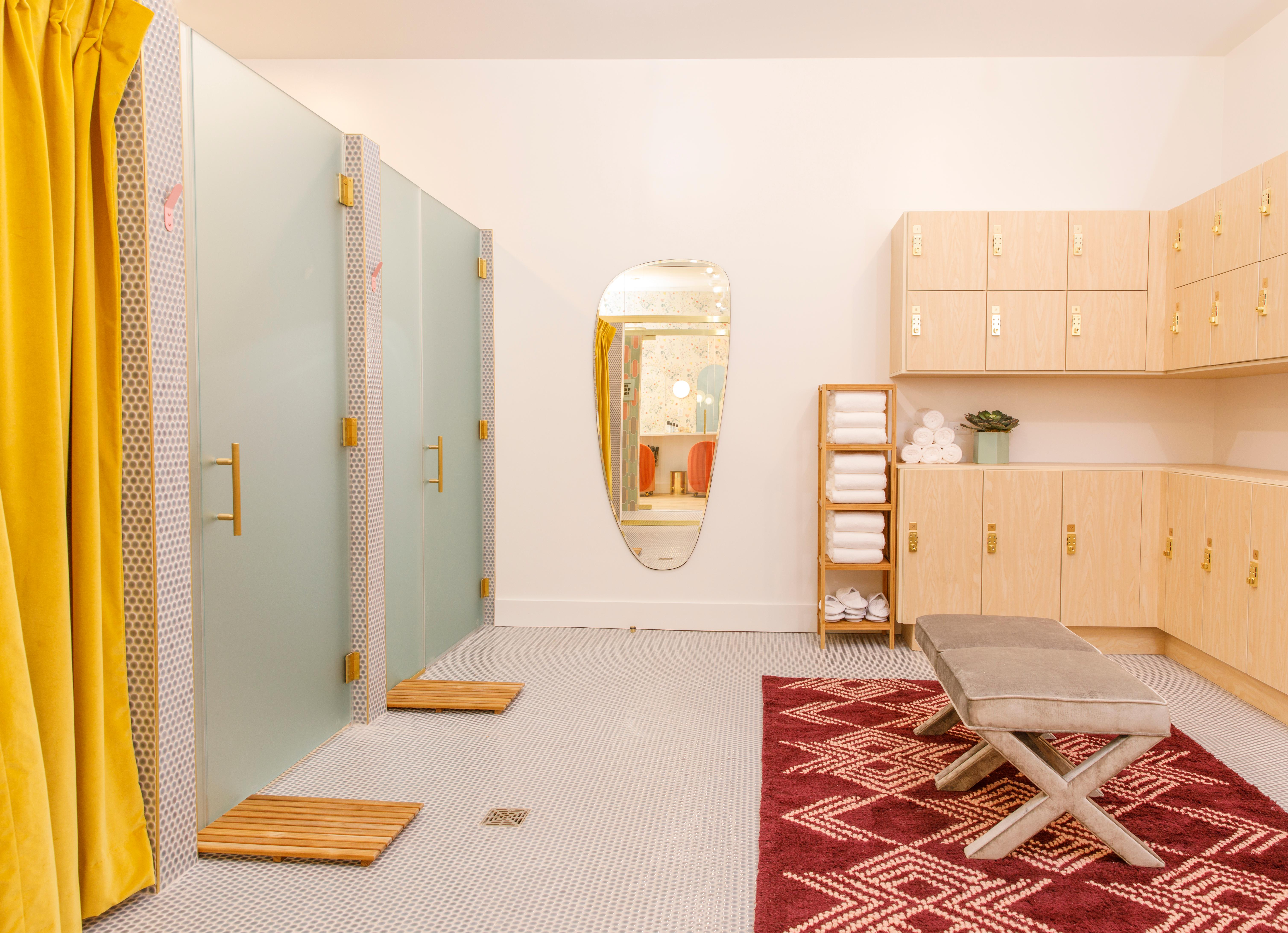 The small locker room, including two showers and a lactation room for new mothers, allows Wing members a space to get ready for big meetings or post-work activities. (Image: Courtesy The Wing)