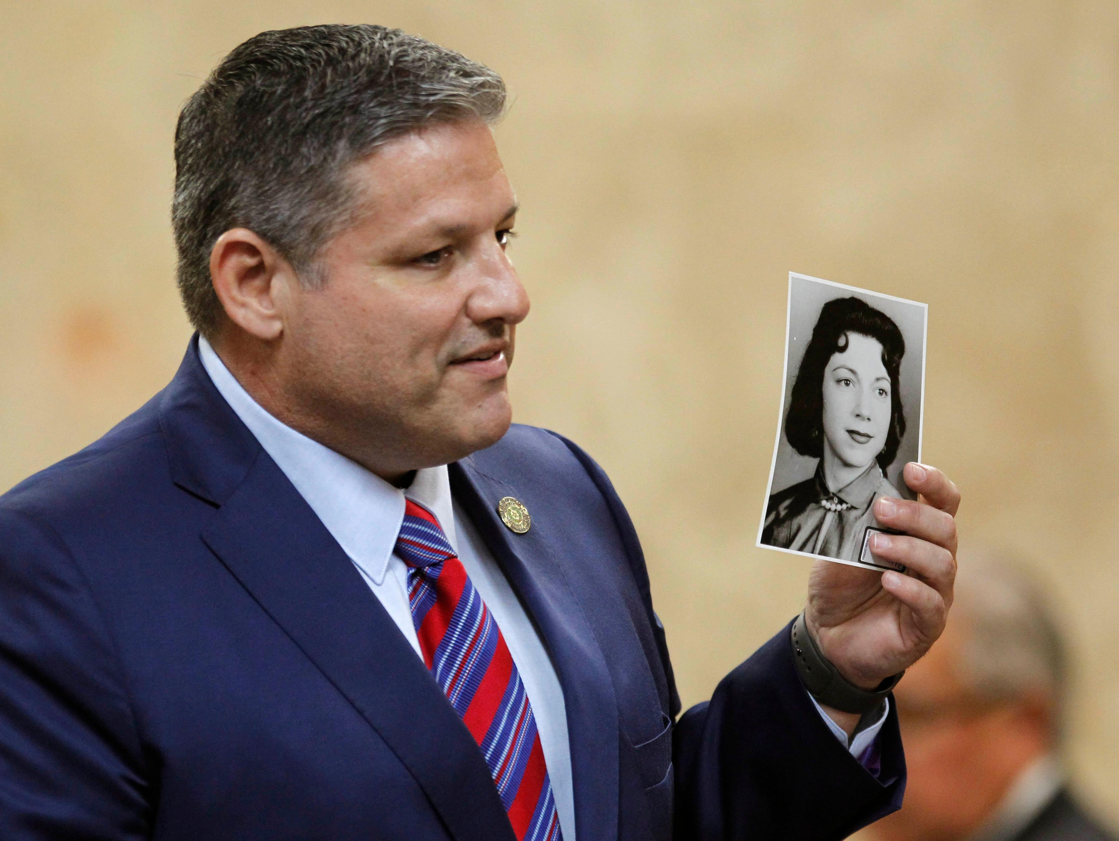 Hidalgo County Assistant District Attorney Michael Garza hold a photograph of Irene Garza as he presents his closing argument in John Bernard Feit's trial for the 1960 murder of Garza in the 92nd state District Court Thursday, December 7, 2017, at the Hidalgo County Courthouse in Edinburg. (Nathan Lambrecht/The Monitor/Pool)