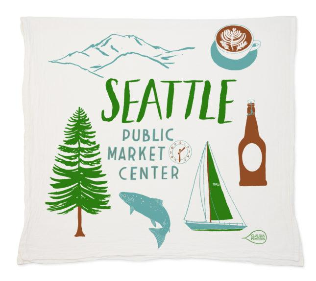 The Seattle Tea Towel by Claudia Pearson highlights our great city on a flour sack towel. Wrap this around a great bottle of wine or with a set of tea bags for a wonderful thank you for a wonderful host. (Image: Claudia Pearson)