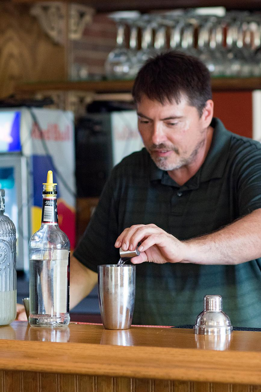 John Caldwell, owner, making a Long Island iced tea{ }/ Image: Allison McAdams // Published: 10.21.18