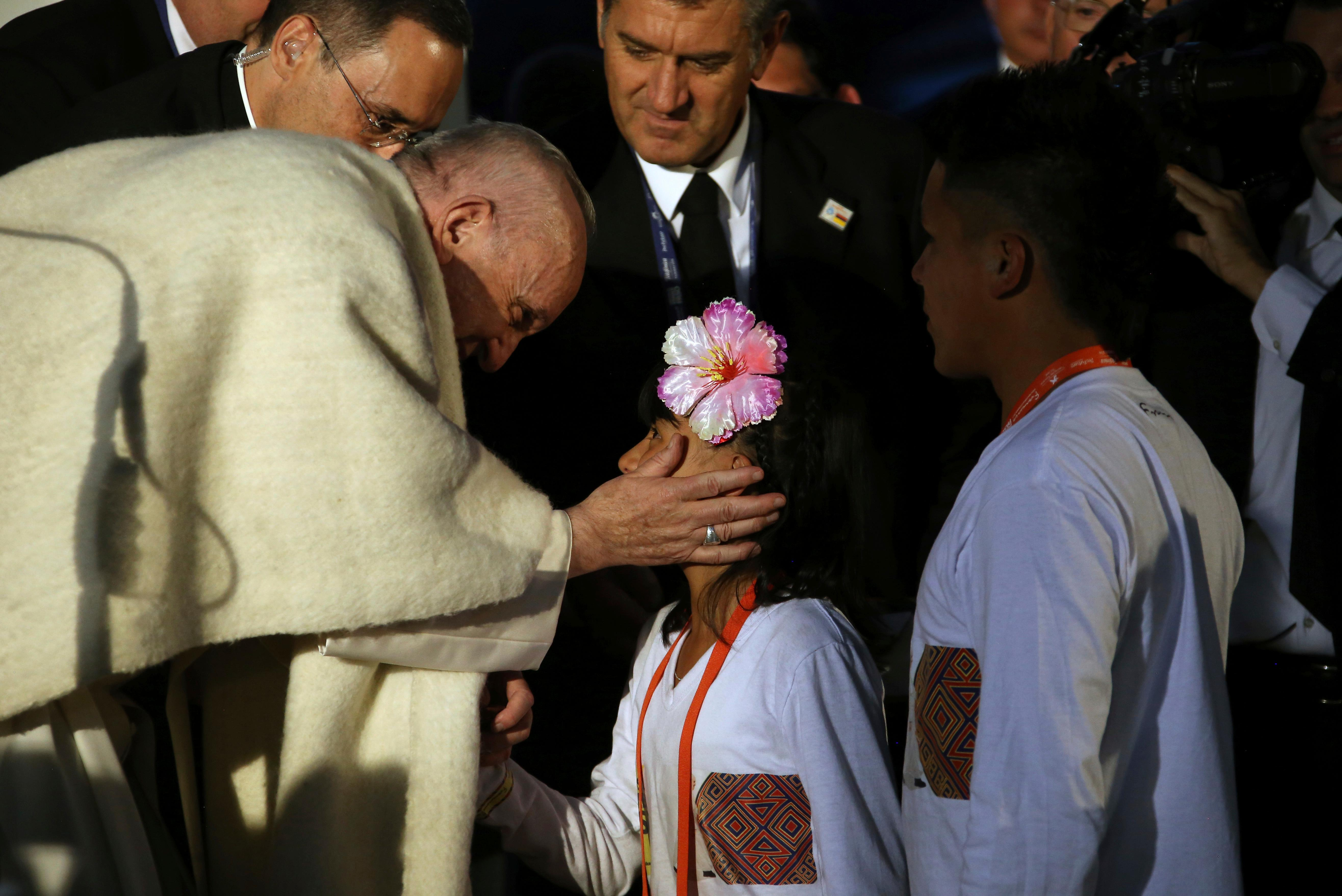 Pope Francis greets a child during his welcoming ceremony at the Nunciature in Bogota, Colombia, Wednesday, Sept. 6, 2017. Pope Francis has arrived in Colombia for a five-day visit. (AP Photo/Ivan Valencia)