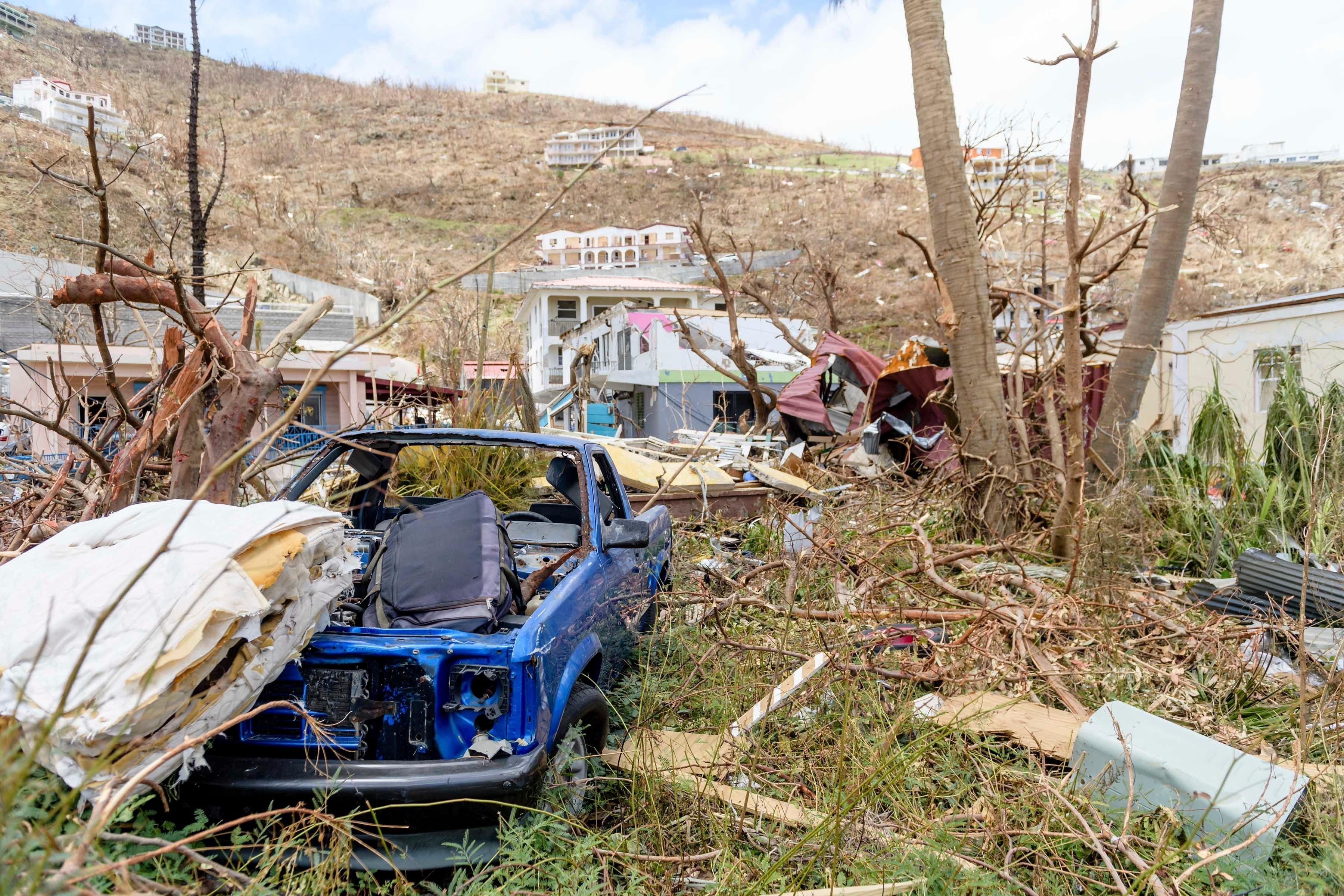 In this undated photo provided on Sunday Sept. 10, 2017, by the British Ministry of Defence, cars that have been turned to wrecks by Hurricane Irma on the British Virgin Islands. The wild isolation that made St. Barts, St. Martin, Anguilla and the Virgin Islands vacation paradises has turned them into cutoff, chaotic nightmares in the wake of Hurricane Irma, which left 22 people dead, mostly in the Leeward Islands. (MOD via AP)