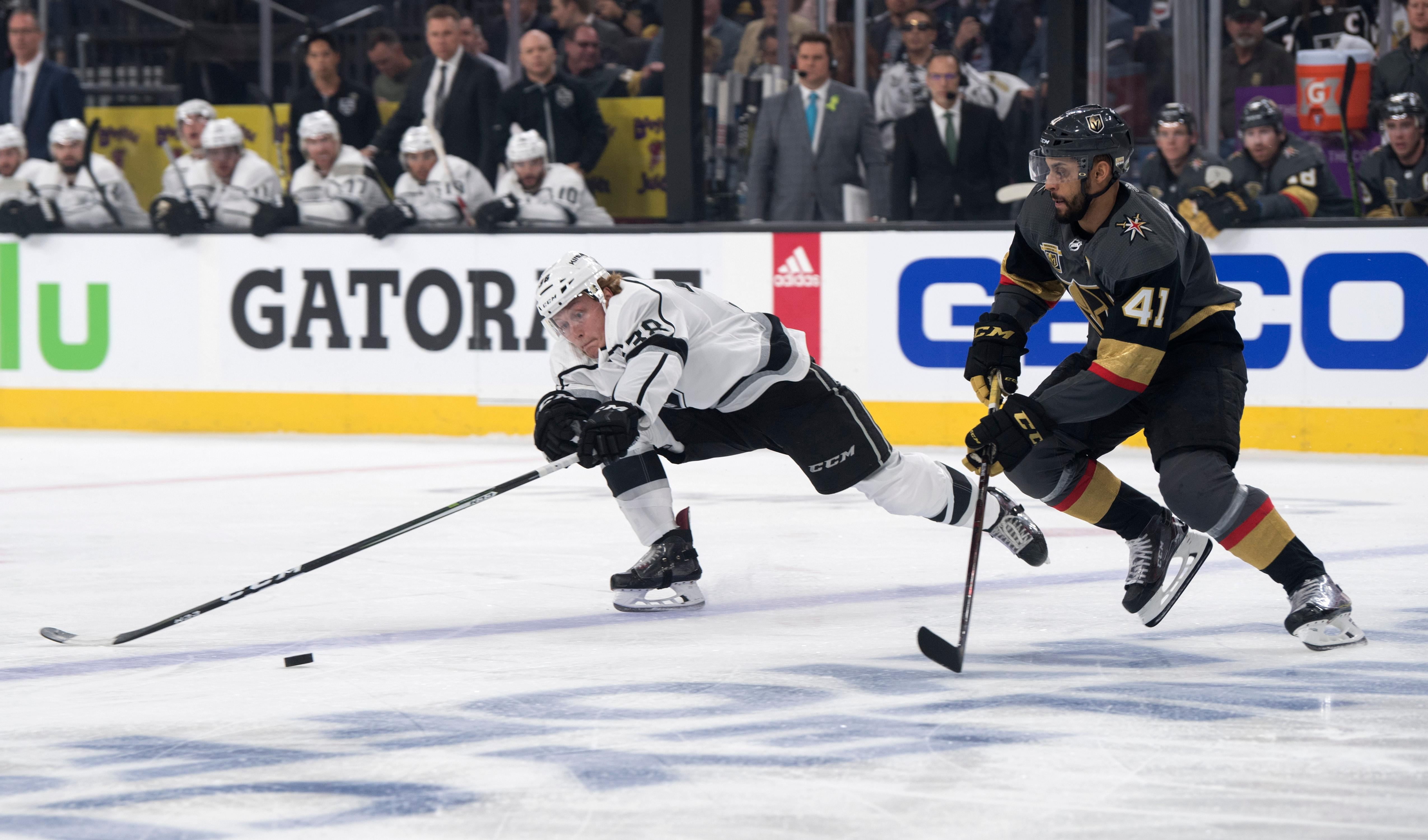 Los Angeles Kings defenseman Paul LaDue (38) and Vegas Golden Knights left wing Pierre-Edouard Bellemare (41) chase down a puck during the first period of Game 1 of their NHL hockey first-round playoff series Wednesday, April 11, 2018 at T-Mobile Arena. The Knights won 1-0. CREDIT: Sam Morris/Las Vegas News Bureau
