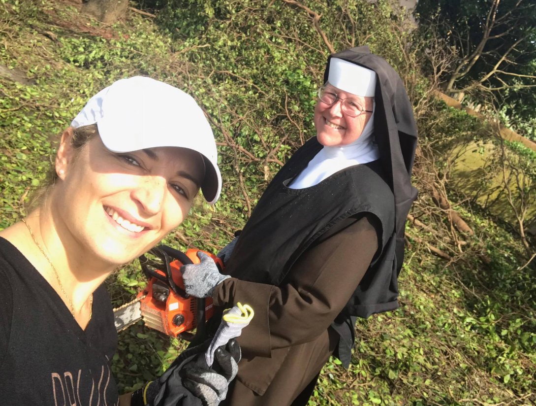 Sister Ann of Archbishop Coleman F. Carroll High School gave an extra helping hand by clearing the neighborhood roads of trees blown over by Hurricane Irma. (MDPD)