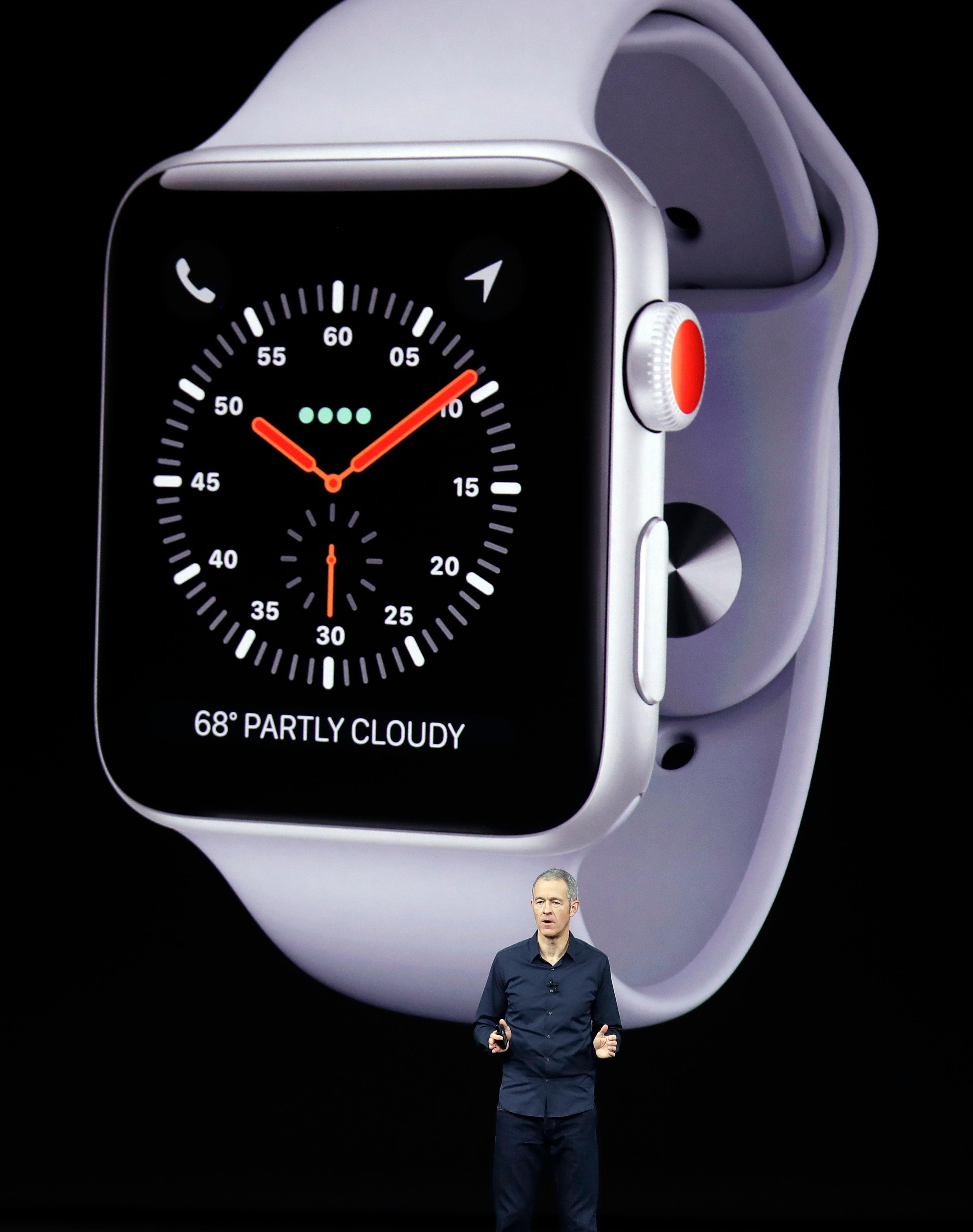 Jeff Williams, Apple's chief operating officer, shows new Apple Watch Series 3 product at the Steve Jobs Theater on the new Apple campus on Tuesday, Sept. 12, 2017, in Cupertino, Calif. (AP Photo/Marcio Jose Sanchez)