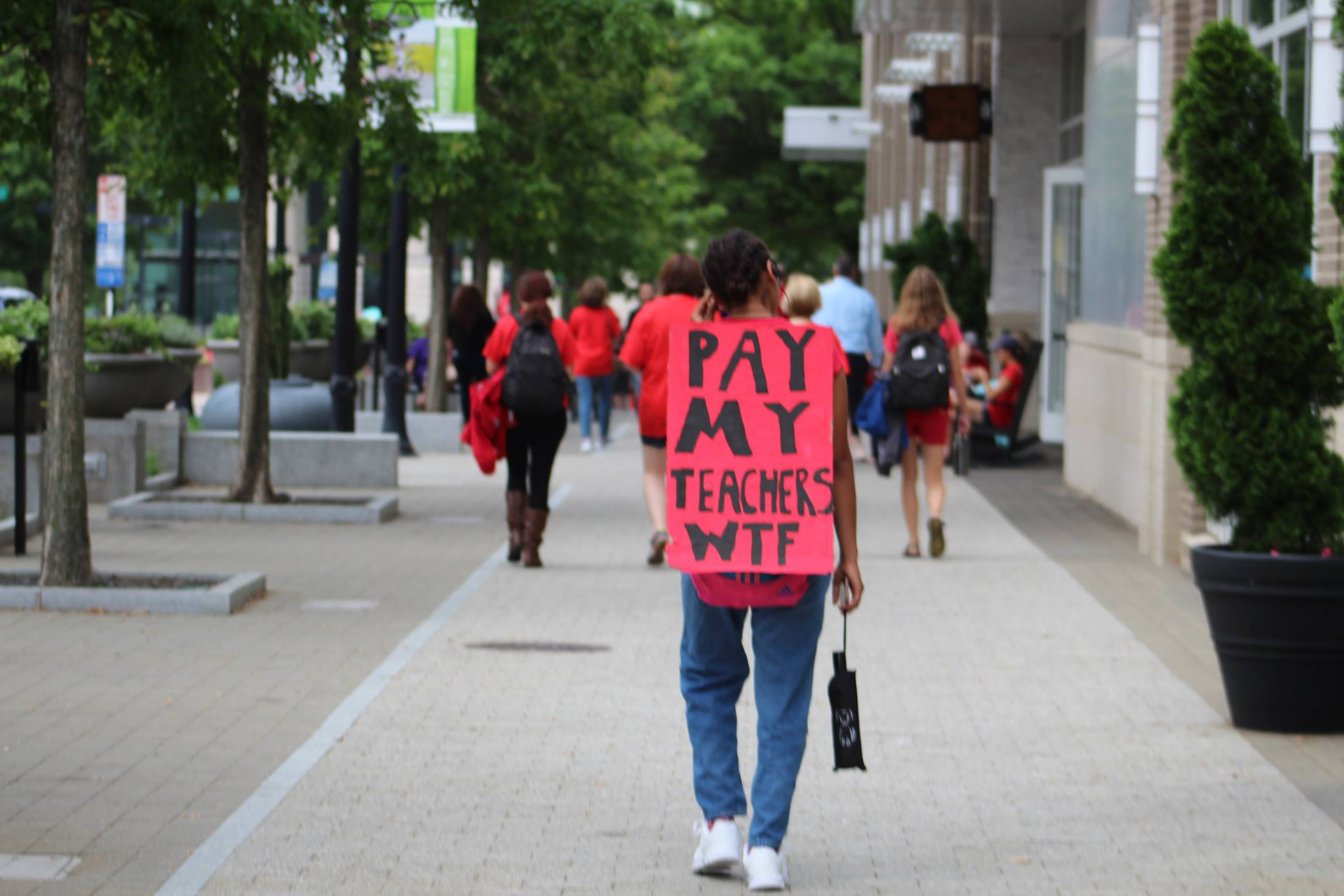 Whether it was students, teachers or other rally-goers, nearly everyone was carrying a sign at Wednesday's rally in Raleigh. (Photo: Linsay Culver)