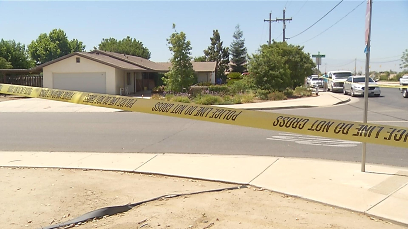 Caution tape is seen Thursday, July 7, 2016, at the scene of a home-invasion robbery and shooting off Stine Road and Ambrister Drive in Bakersfield, Calif. (KBAK/KBFX photo/Adam Herbets)