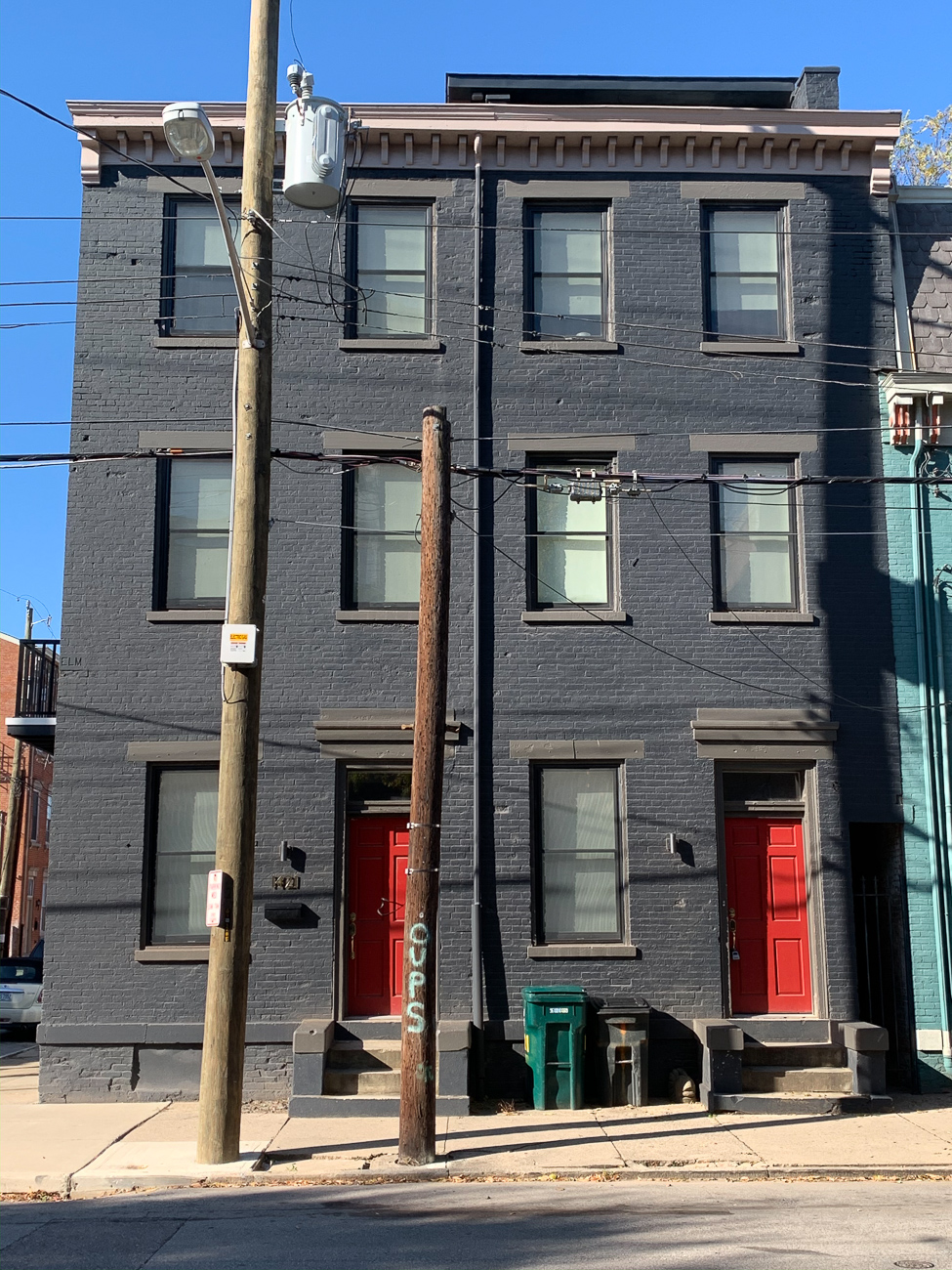 Over-the-Rhine has seen a lot of change in the last decade. Many vacant, historic buildings have received updates and are now occupied by businesses and residents alike. One building at the corner of Elm and Magnolia Streets was empty for nearly 20 years before it was purchased and renovated. 1421 Elm Street became the personal residence for Eric Haberthier and his family of four after construction finished. / Image: Phil Armstrong // Published: 12.6.19