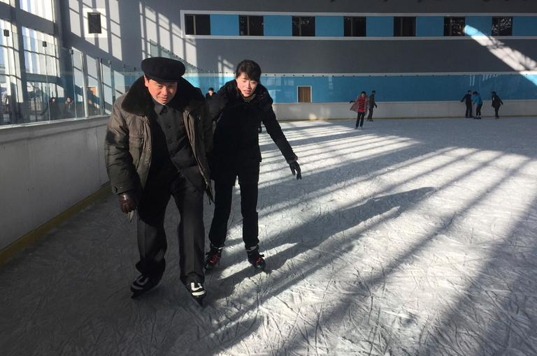 In this Thursday, Feb. 1, 2018, photo, a couple enjoy ice skating at the Outdoor Skating Rink in Pyongyang, North Korea. Though not known as a winter sports power, North Korea will be joining in the Pyeongchang Games set to begin on Feb. 9. (AP Photo/Eric Talmadge)