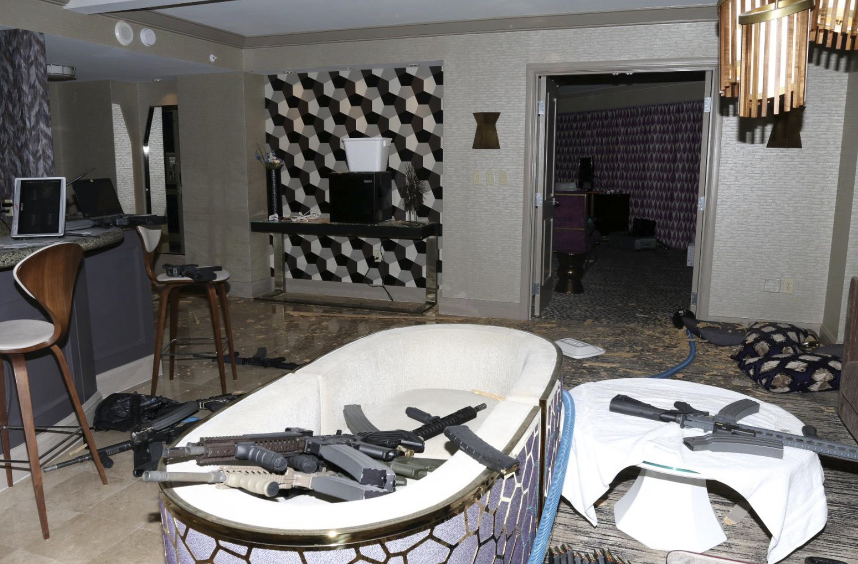 FILE - This Oct. 2017 file photo released by the Las Vegas Metropolitan Police Department Force Investigation Team Report shows the interior of Las Vegas shooter Stephen Paddock's 32nd floor room of the Mandalay Bay hotel. An autopsy found Las Vegas shooter Stephen Paddock had anti-anxiety drugs in his system but was not under the influence of them and was otherwise healthy. The report released Friday, Feb. 9, 2018, showed signs of benzodiazepines in Paddock's system but said because the substances were found in his urine and not his blood, Paddock wasn't under the influence of the medication. It said he was overweight but otherwise healthy. Paddock killed 58 people and injured more than 800 others during the Oct. 1 massacre. (Las Vegas Metropolitan Police Department via AP, File)