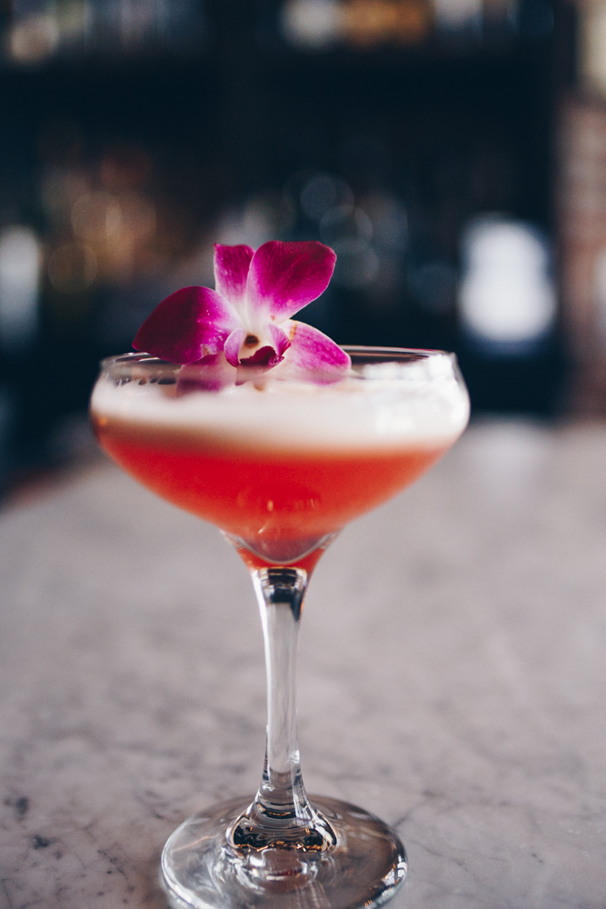 Pretty in Pink: Uncle Val's Botanical Gin, St. Germain, cucumber juice, lemon, raspberries, and a micro flower / Image: Catherine Viox // Published: 5.8.18