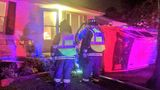 Car runs into Quincy home