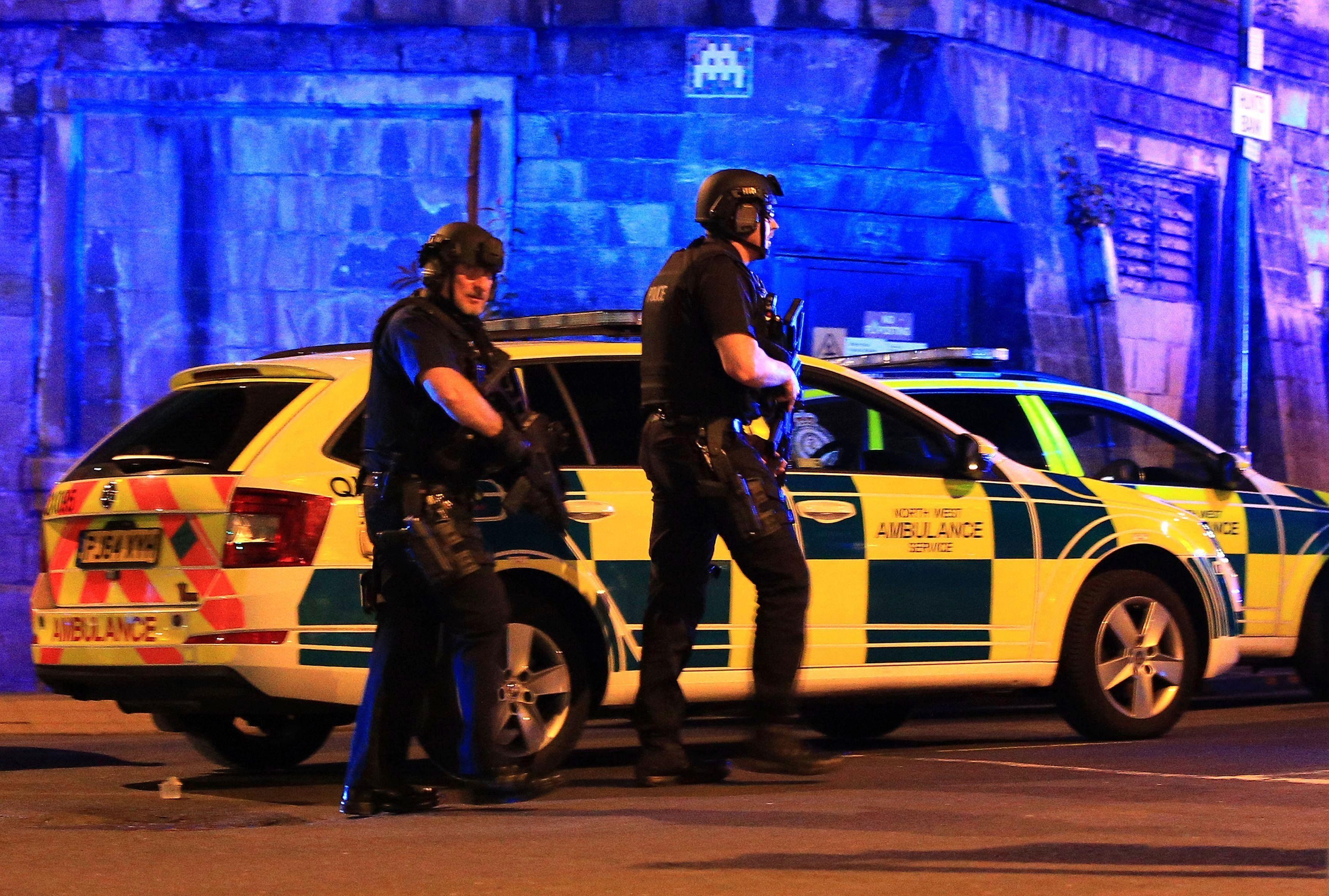 Armed police work at Manchester Arena after reports of an explosion at the venue during an Ariana Grande gig in Manchester, England Monday, May 22, 2017. (Peter Byrne/PA via AP)
