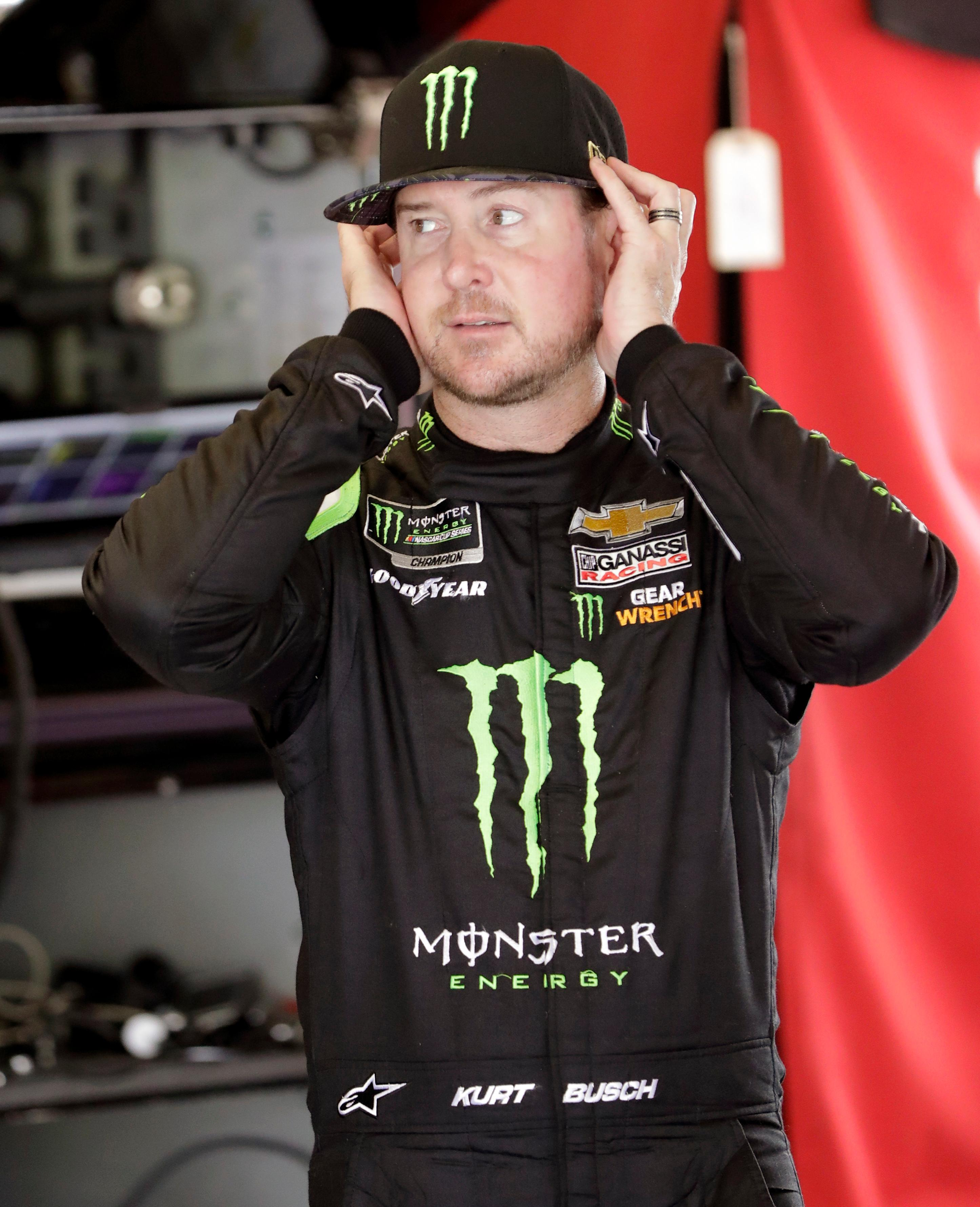 Kurt Busch adjusts his hat after driving in a NASCAR auto racing practice for the Daytona 500 at Daytona International Speedway, Saturday, Feb. 16, 2019, in Daytona Beach, Fla. (AP Photo/John Raoux)
