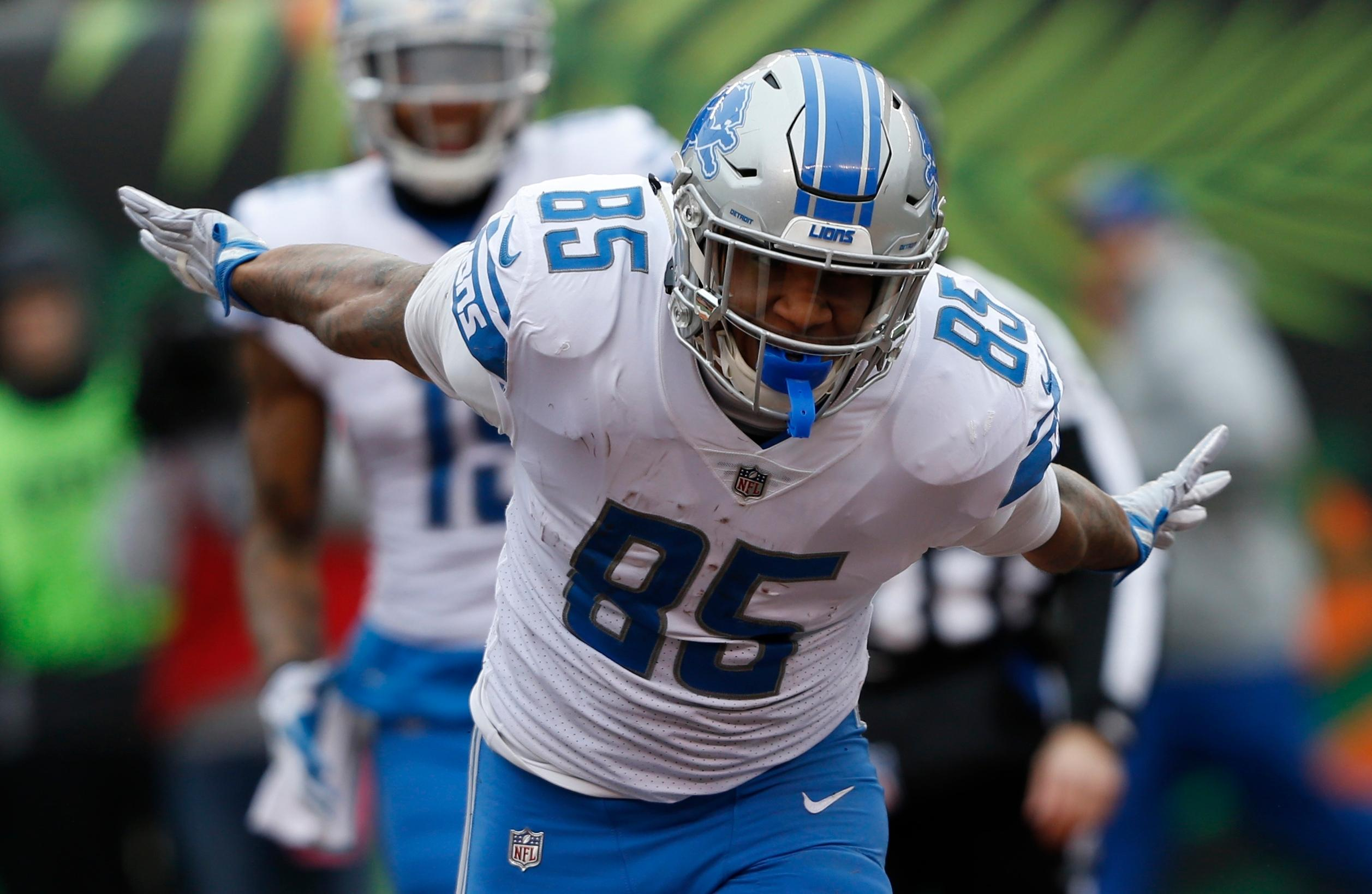 Detroit Lions tight end Eric Ebron (85) celebrates after his 33-yard reception for a touchdown during the first half of an NFL football game against the Cincinnati Bengals, Sunday, Dec. 24, 2017, in Cincinnati. (AP Photo/Frank Victores)