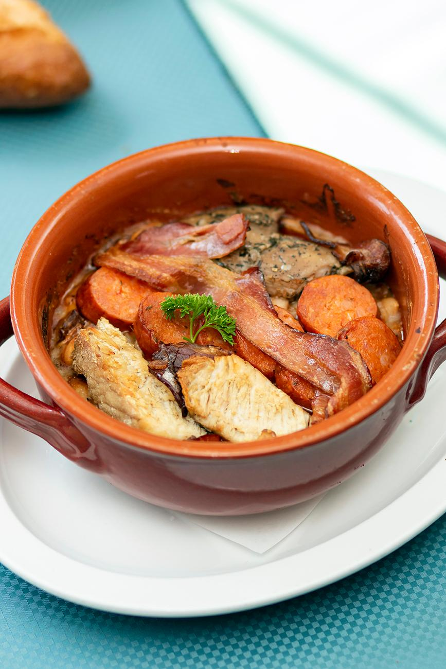 <p>Cassoulet: a southwest France specialty of pork and duck on a bed of twice cooked white beans with bacon, thyme, and cloves in a tomato-based gravy / Image: Allison McAdams // Published: 8.19.19</p>