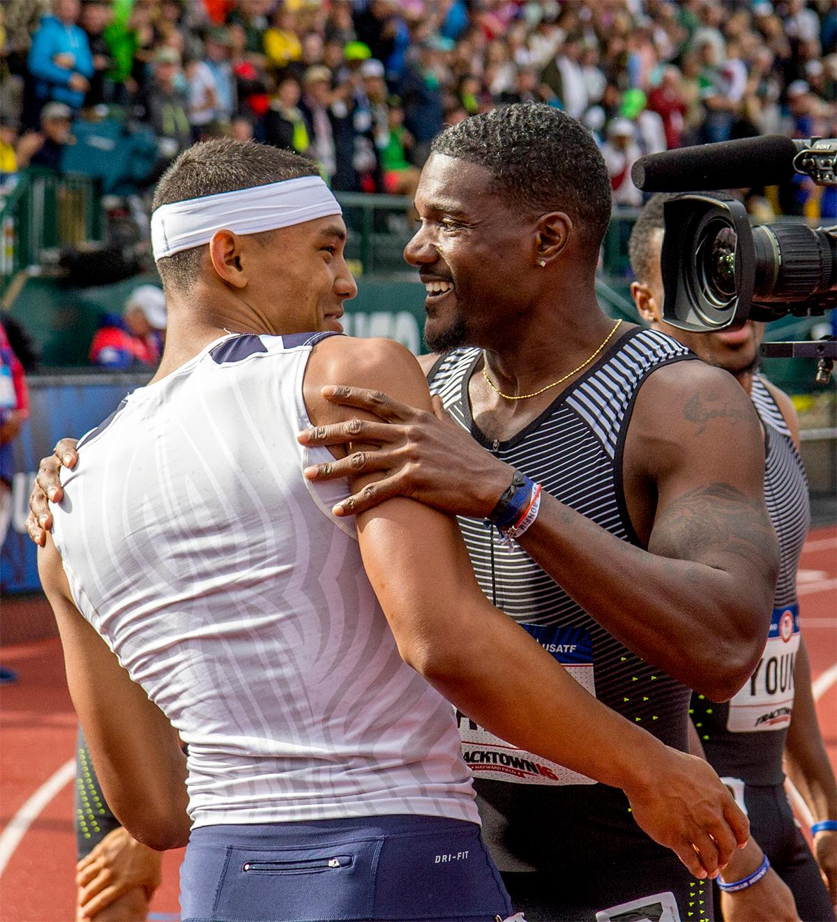 Nike's LaShawn Merritt and high school athlete Michael Norman congratulate each other on winning each of their heats in the 200 meter semi-finals and moving on to the finals. Photo by August Frank, Oregon News Lab