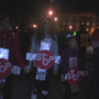 "Dozens of people walk in a ""Stop the Killing"" march in Danville"