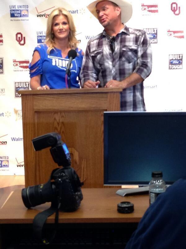 Garth Brooks and wife Trisha Yearwood speak with the media prior to the concert.