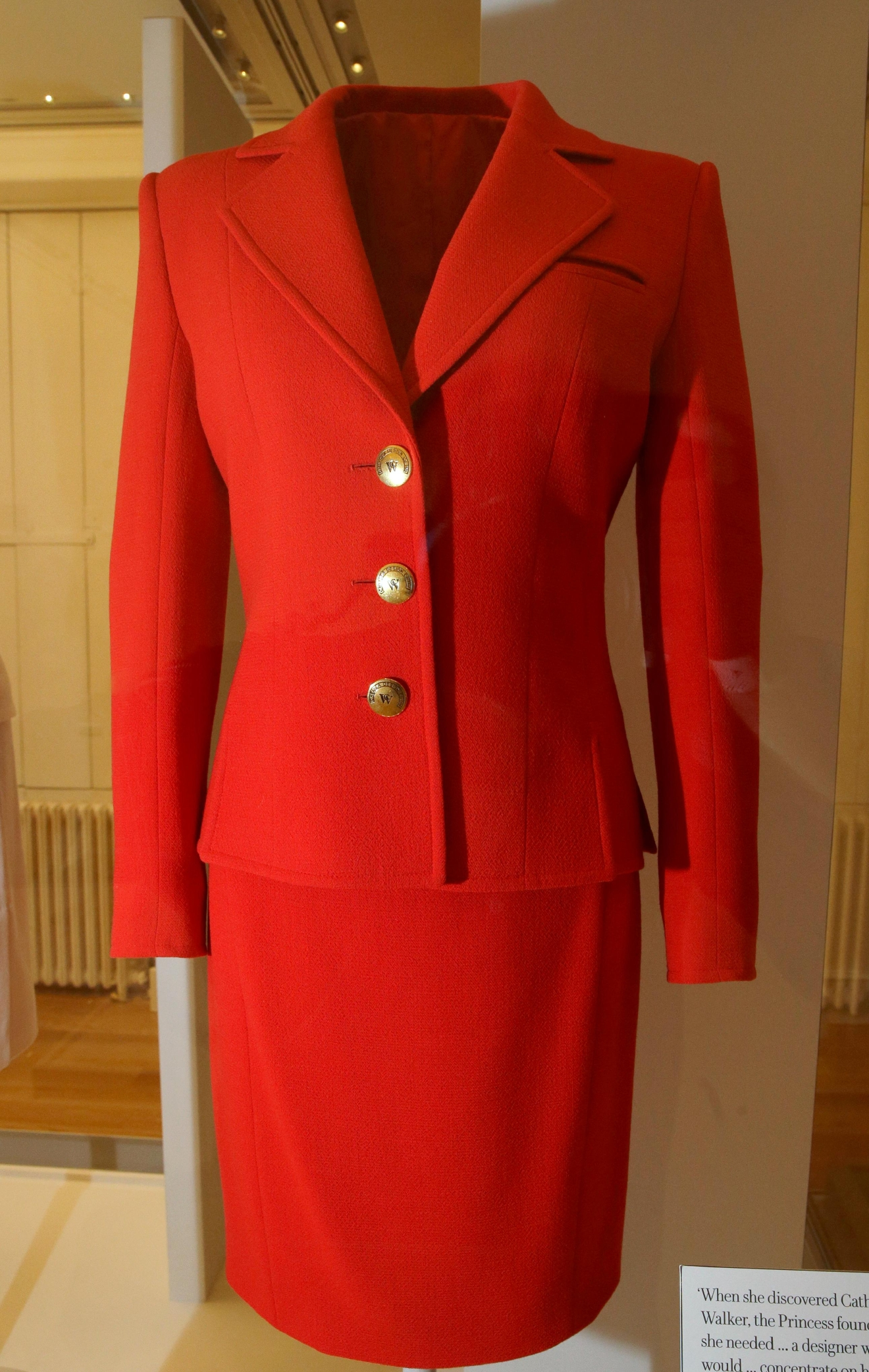 "A red day suit designed by Caroline Walker, and worn by Diana, Princess of Wales in 1996 when she launched a HIV/Aids Charity London Lighthouse appeal, is on display during a media preview of an exhibition of 25 dresses and outfits worn by Diana entitled ""Diana: Her Fashion Story"" at Kensington Palace in London, Wednesday, Feb. 22, 2017. (AP Photo/Alastair Grant)"