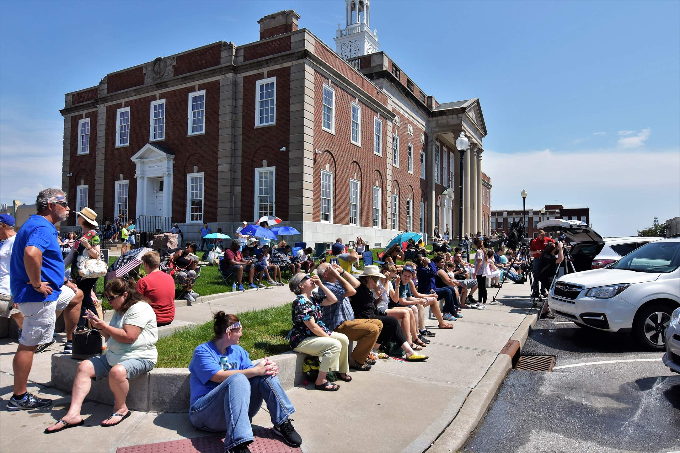 Anticipation builds as spectators at the Independence Square view the start of the partial eclipse. [David M. Rainey/Special to The Examiner]