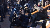 Protesters face off in Red Square as police use pepper spray, handcuffs
