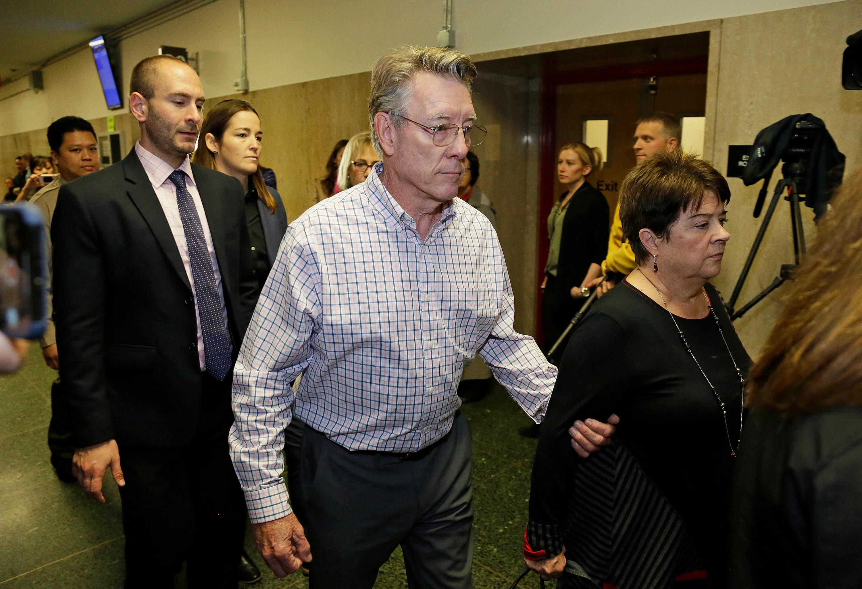 Jim Steinle, center, and Liz Sullivan, right, the parents of Kate Steinle, walk to a court room for closing arguments in the trial of Jose Ines Garcia Zarate accused of killing their daughter, on Monday, Nov. 20, 2017, in San Francisco. Jose Ines Garcia Zarate had been deported five times and was wanted for a sixth deportation when Kate Steinle was fatally shot in the back while walking with her father on the pier. (AP Photo/Eric Risberg)