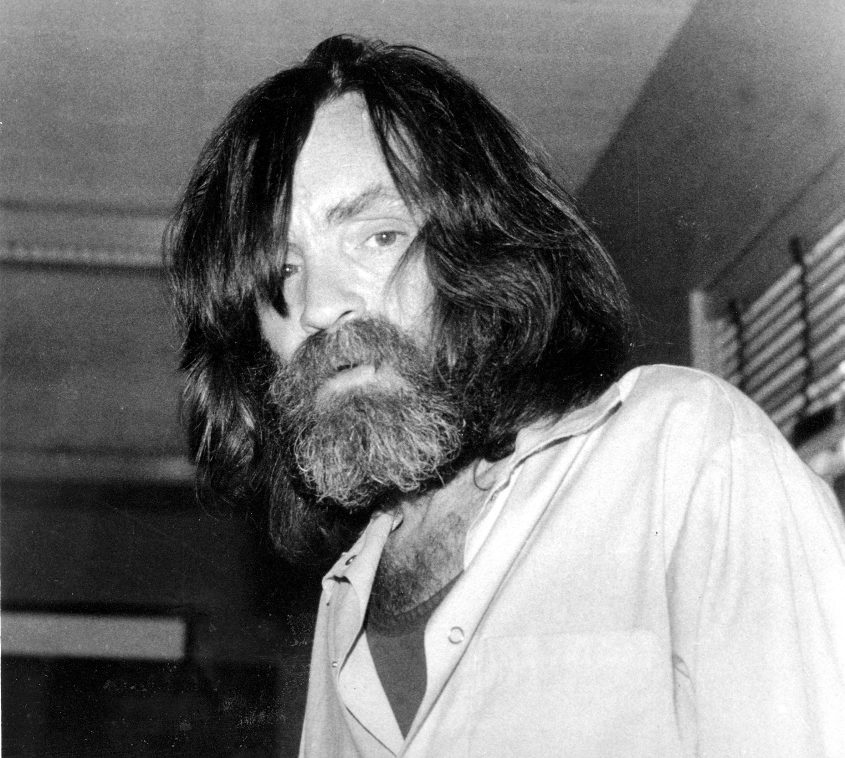 FILE - In this June 10, 1981 file photo, convicted murderer Charles Manson is photographed during an interview with television talk show host Tom Snyder in a medical facility in Vacaville, Calif. (AP Photo, File)<p></p>
