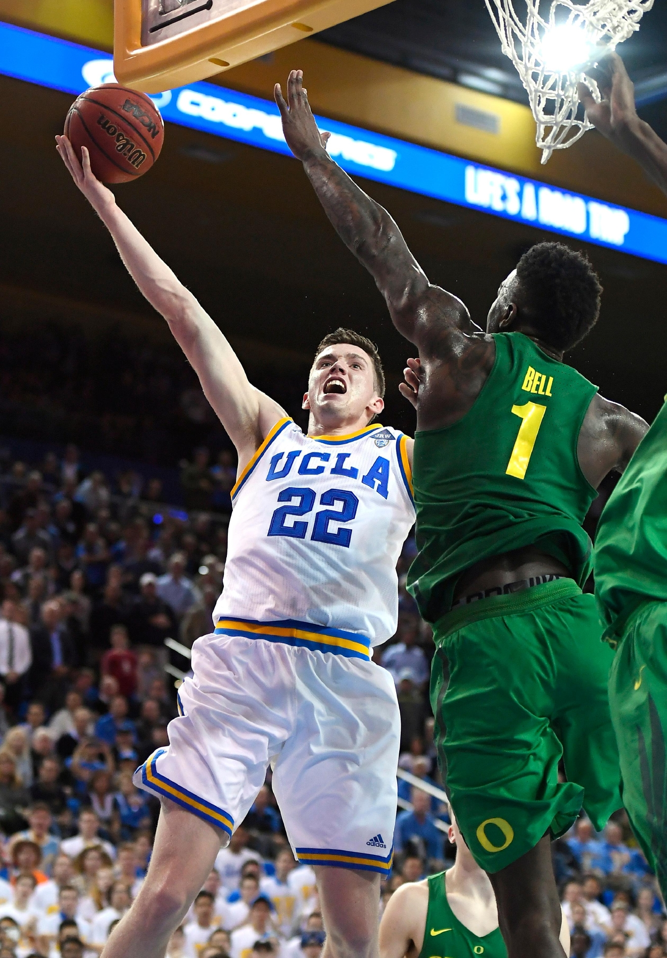 UCLA forward TJ Leaf, left, shoots as Oregon forward Jordan Bell defends during the second half of an NCAA college basketball game, Thursday, Feb. 9, 2017, in Los Angeles. UCLA won 82-79. (AP Photo/Mark J. Terrill)