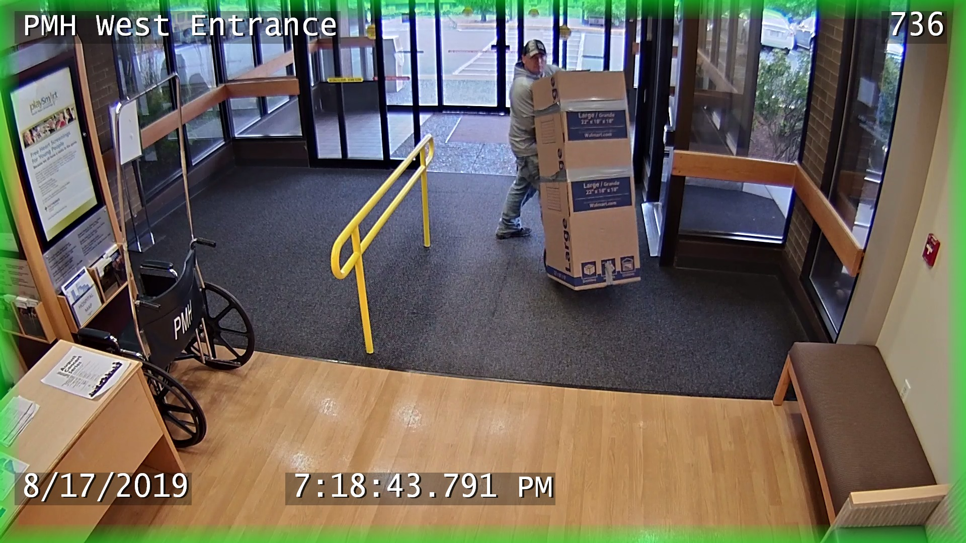 Still photos from surveillance footage inside Providence Milwaukie Hospital show a man wheeling an ATM covered by a cardboard box out the hospital with a hand cart August 17. If you recognize the suspect, call Milwaukie Police. (Photo courtesy of Milwaukie Police)