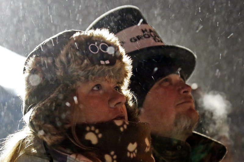 <p>Jackie and Jimmy Wilson watch a fireworks display during the 132nd Groundhog Day on Gobbler's Knob in Punxsutawney, Pa. Friday, Feb. 2, 2018. (AP Photo/Gene J. Puskar)</p>