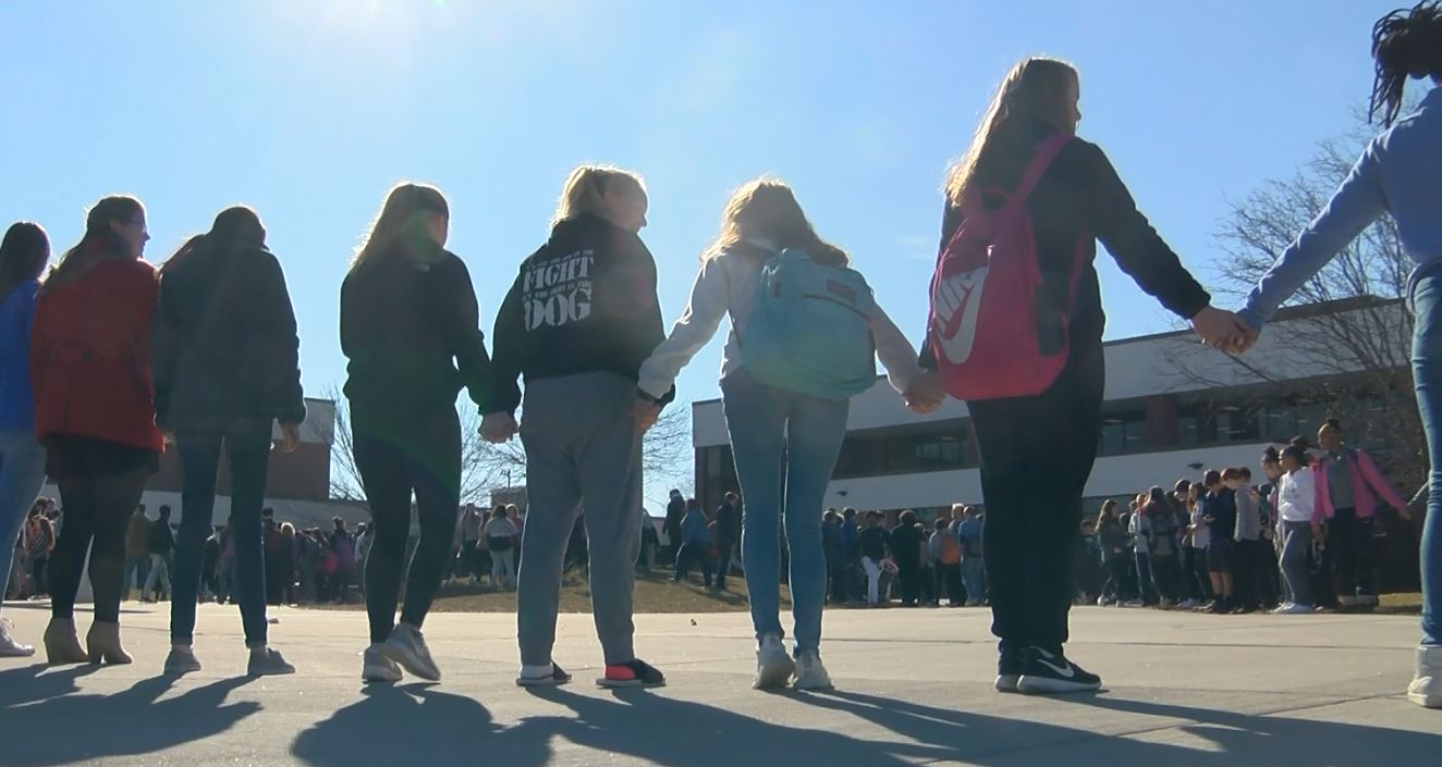 Quincy High School students link arms to remember the 17 high school students killed at the Parkland High School mass shooting on Valentines Day (KHQA/Marcus Espinoza).{&amp;nbsp;}<p></p>