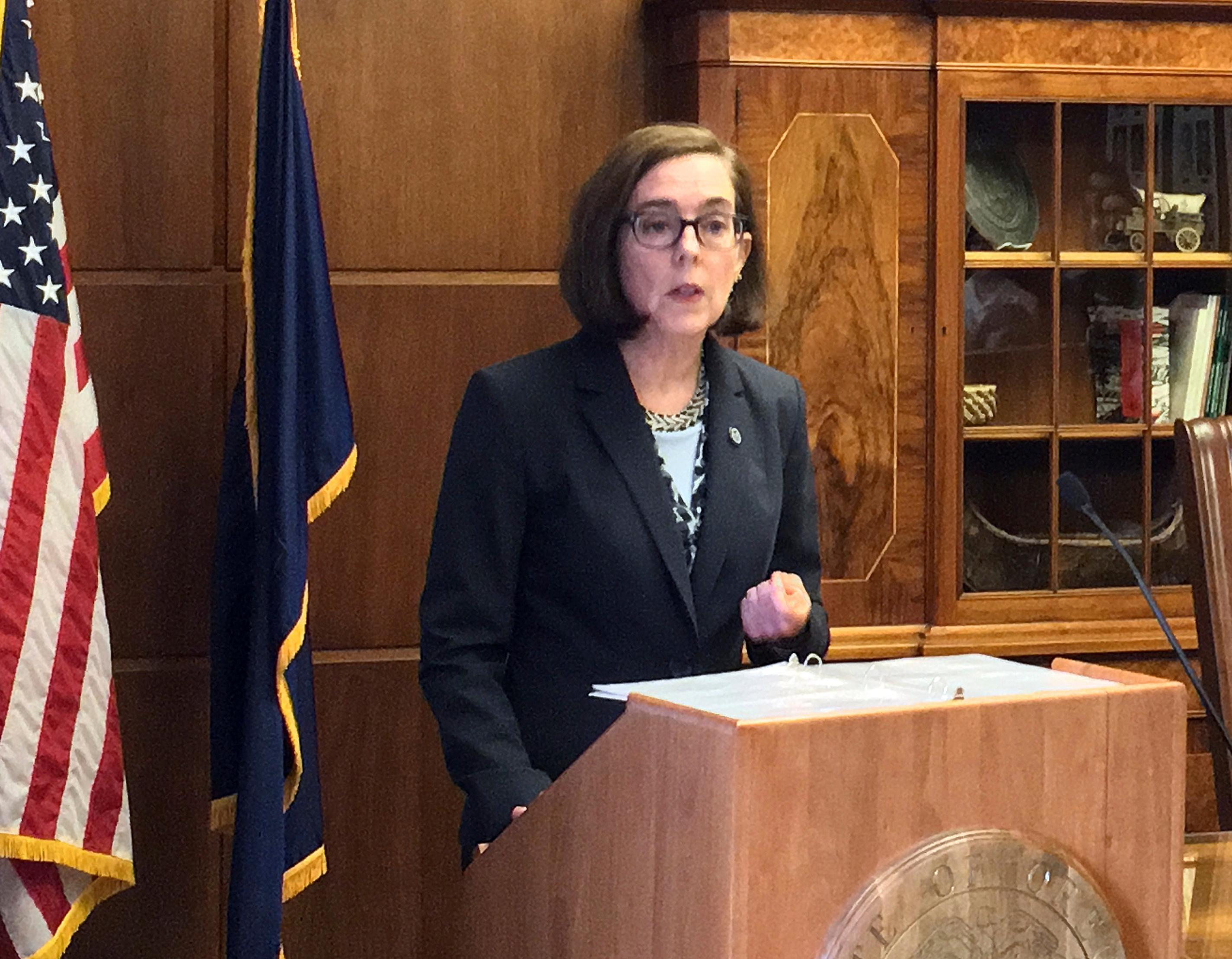 FILE - In this April 27, 2017, file photo, Oregon Gov. Kate Brown speaks in the Capitol ceremonial office in Salem, Ore. Oregon voters will choose candidates Tuesday, May 15, 2018, to compete in the state's general election, a primary contest that sees Democrats striving to consolidate power while Republicans hope to make gains. (AP Photo/Kristena Hansen, File)