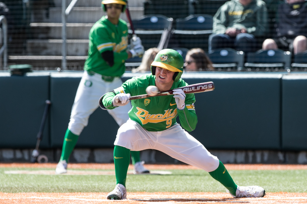 Oregon Ducks infielder Morgan McCullough (#9) sets up a bunt. In the second of the three game series, the Ducks beat the UC Irvine Anteaters 6-3. Photo by Austin Hicks, Oregon News Lab
