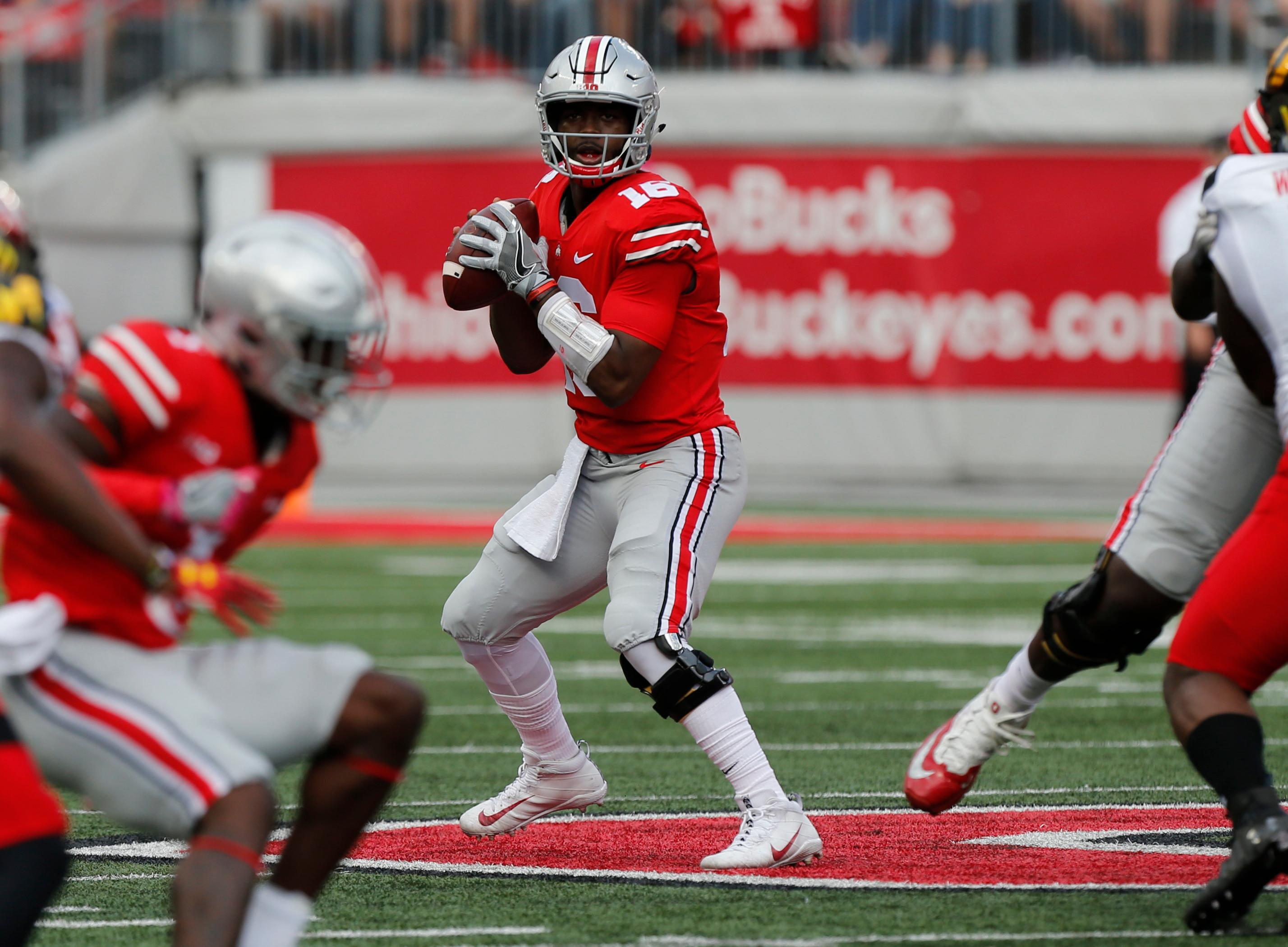 Ohio State quarterback J.T. Barrett drops back to pass against Maryland during the first half of an NCAA college football game Saturday, Oct. 7, 2017, in Columbus, Ohio. (AP Photo/Jay LaPrete)