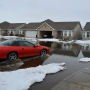 Melting snow causes flooding in Cottonwood Grove subdivision