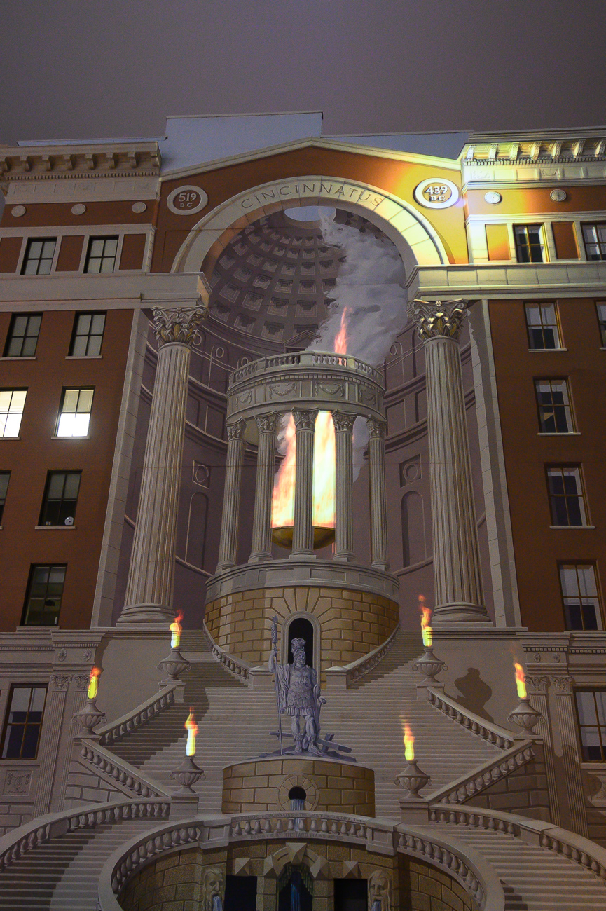 PICTURED NEIGHBORHOOD: Downtown / The Cincinnatus mural at Vine and Central Parkway is animated with glowing orbs and fire. / Image: Phil Armstrong // Published: 10.12.19