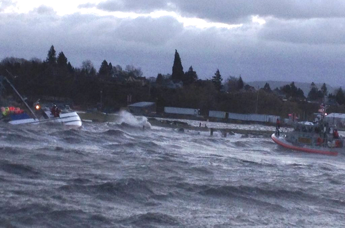 High winds wash a fishing boat onto the rocks in Bellingham. (U.S. Coast Guard photo)