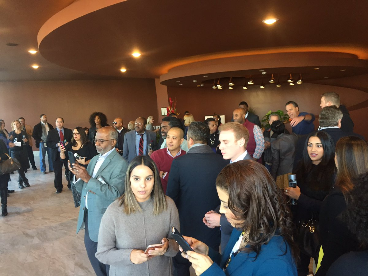 Tons of people are crowded in the Eclipse Theater lobby for the grand opening. 12/8/16 (Faith Jessie | KSNV)