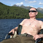 Russia's Putin shows off spoils from Siberia fishing trip