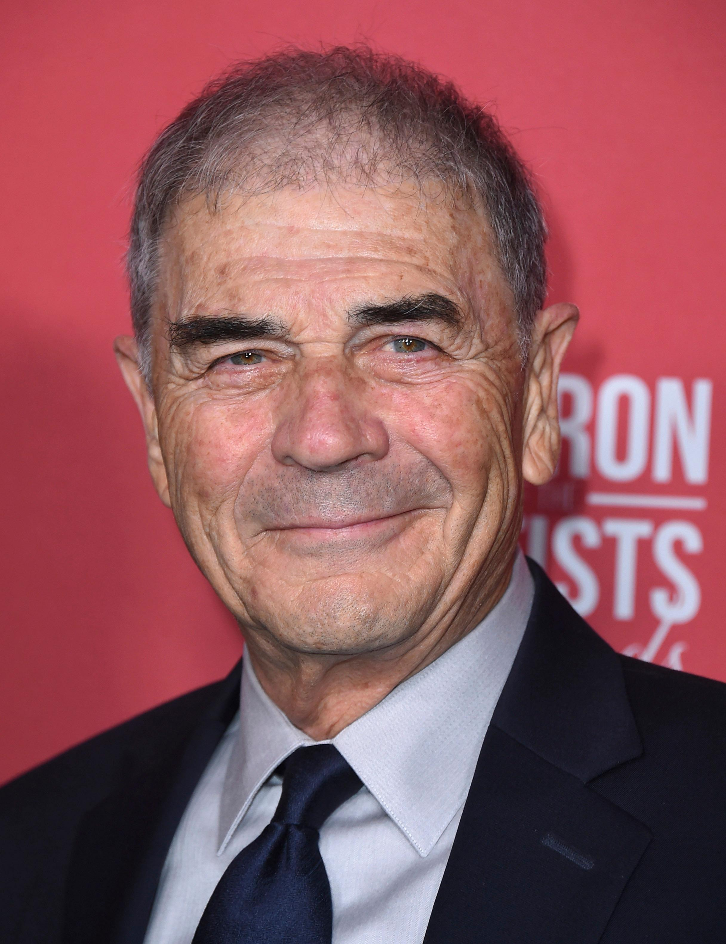 "FILE - In this Nov. 8, 2018, file photo, Robert Forster arrives at the Patron of the Artists Awards at the Wallis Annenberg Center for the Performing Arts in Beverly Hills, Calif. Forster, the handsome character actor who got a career resurgence and Oscar-nomination for playing bail bondsman Max Cherry in ""Jackie Brown,"" has died at age 78. Forster's agent Julia Buchwald says he died Friday, Oct. 11, 2019, at home in Los Angeles of brain cancer. (Photo by Jordan Strauss/Invision/AP, File)"