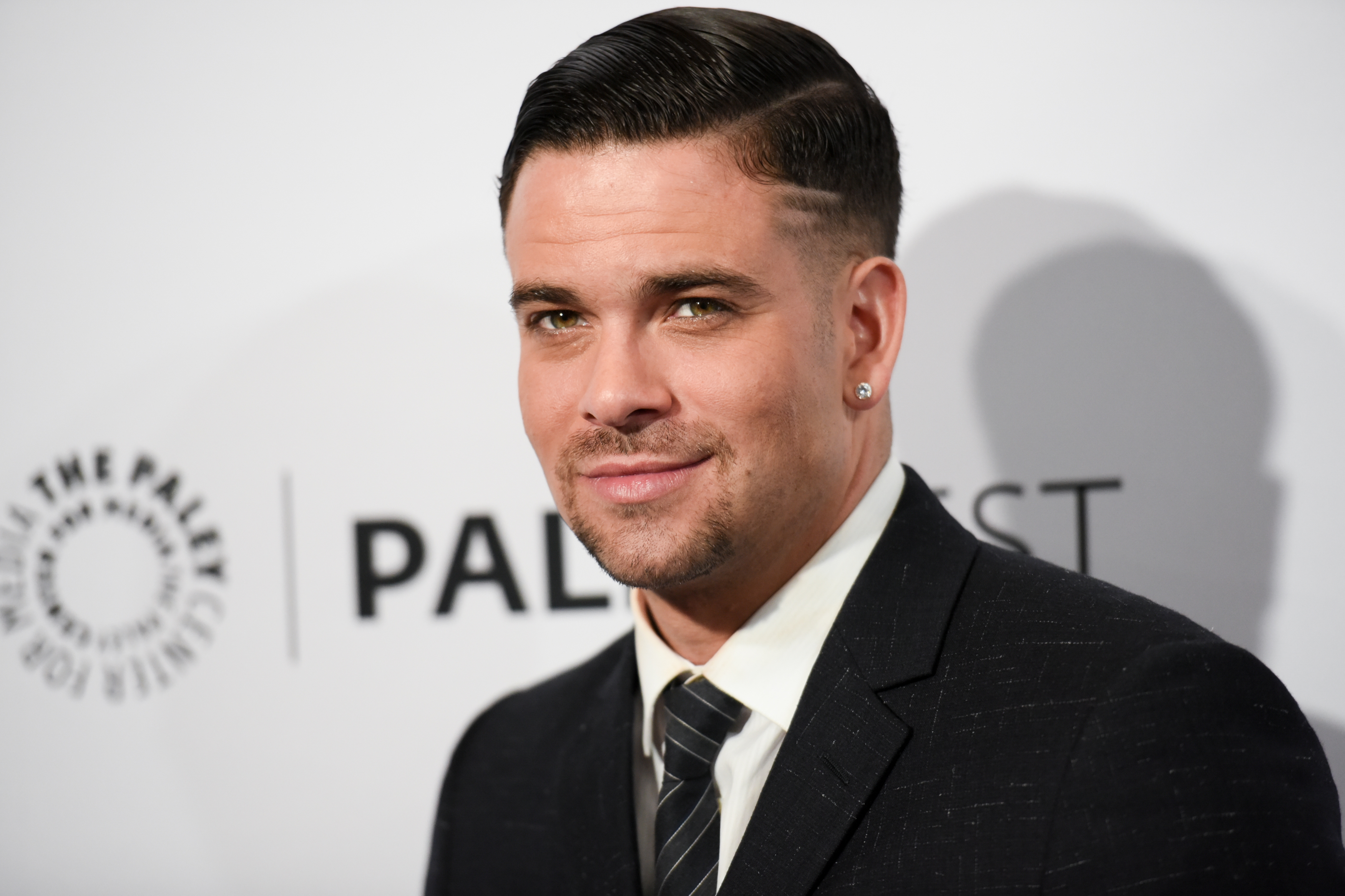 "FILE - In this March 13, 2015 file photo, Mark Salling arrives at the 32nd Annual Paleyfest ""Glee"" held at The Dolby Theatre in Los Angeles. Authorities say former Â?GleeÂ? star Salling has been arrested in Los Angeles for investigation of possessing child pornography. Los Angeles Police officer Tony Im says the 33-year-old actor was taken into custody Tuesday, Dec. 29, 2015, after a warrant was served at his home in the Sunland neighborhood. (Photo by Richard Shotwell/Invision/AP, File)"