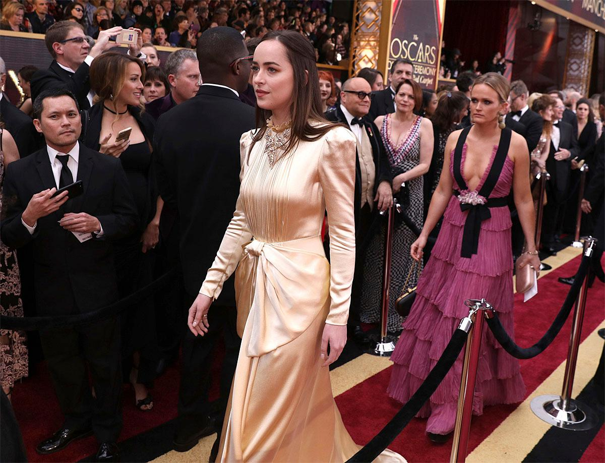 Dakota Johnson arrives at the Oscars on Sunday, Feb. 26, 2017, at the Dolby Theatre in Los Angeles. (Photo by Matt Sayles/Invision/AP)