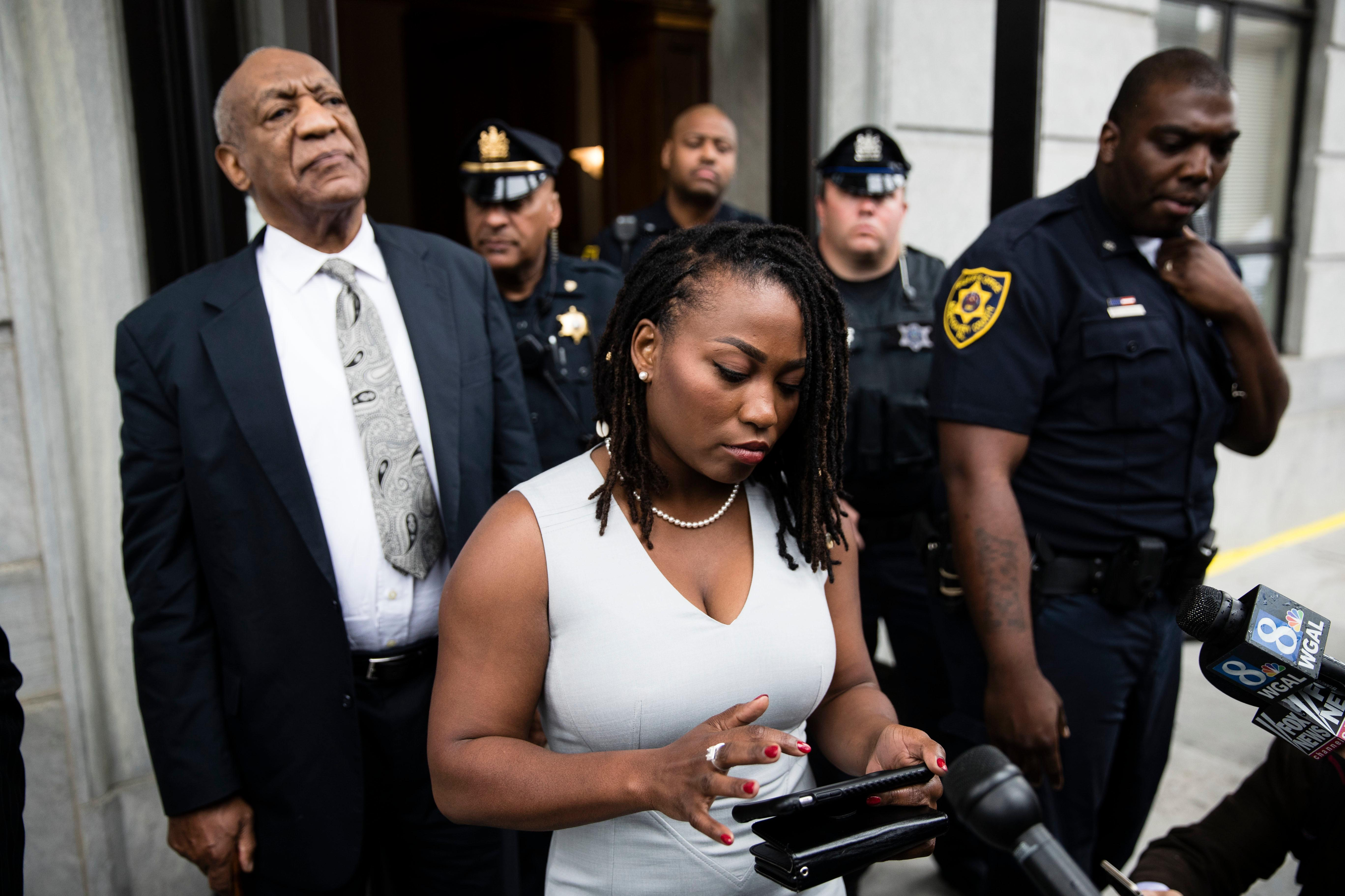 Bill Cosby listens to his wife Camille's statement being read aloud by Ebonee M. Benson outside the Montgomery County Courthouse after a mistrial in his sexual assault case in Norristown, Pa., Saturday, June 17, 2017. Cosby's trial ended without a verdict after jurors failed to reach a unanimous decision. (AP Photo/Matt Rourke)