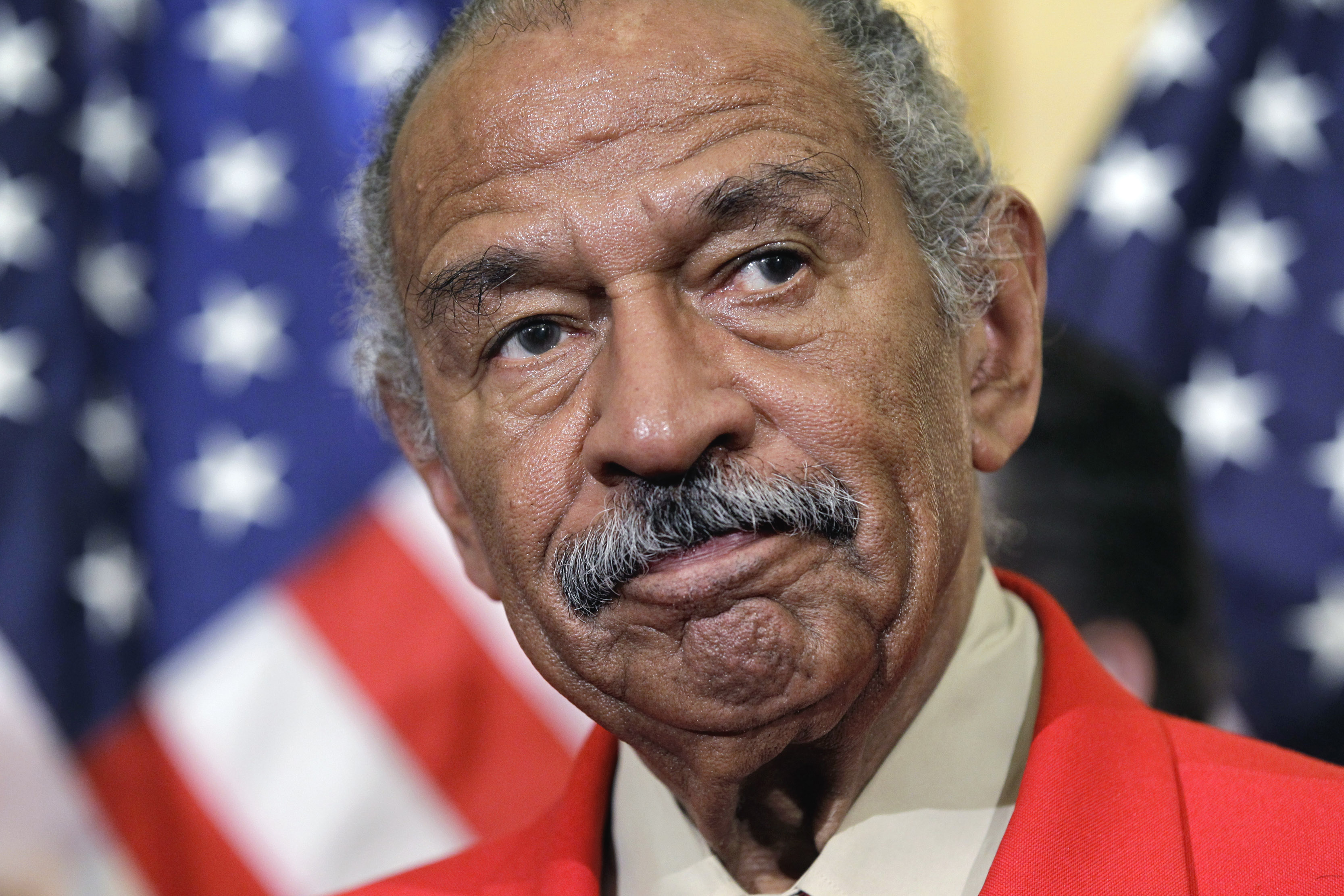 File - In this April 4, 2011 file photo, Rep. John Conyers, D-Mich., the ranking member of the House Judiciary Committee, listens during a news conference on Capitol Hill in Washington.  Top House Democrat Nancy Pelosi says Conyers, facing sexual misconduct allegations, should resign. (AP Photo/J. Scott Applewhite)