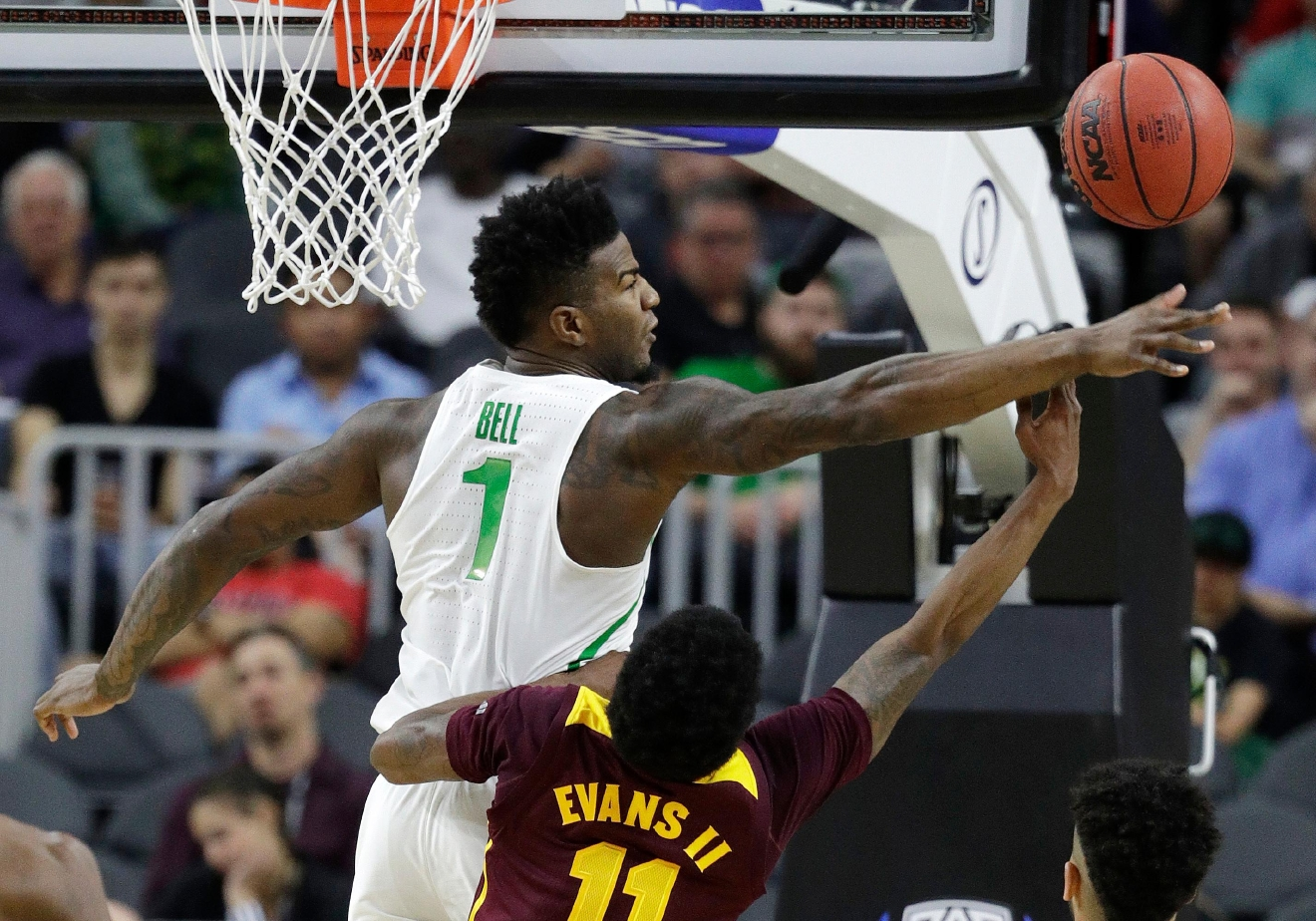 Oregon's Jordan Bell, left, tries to block a shot by Arizona State's Shannon Evans II during the first half of an NCAA college basketball game in the quarterfinals of the Pac-12 men's tournament Thursday, March 9, 2017, in Las Vegas. (AP Photo/John Locher)