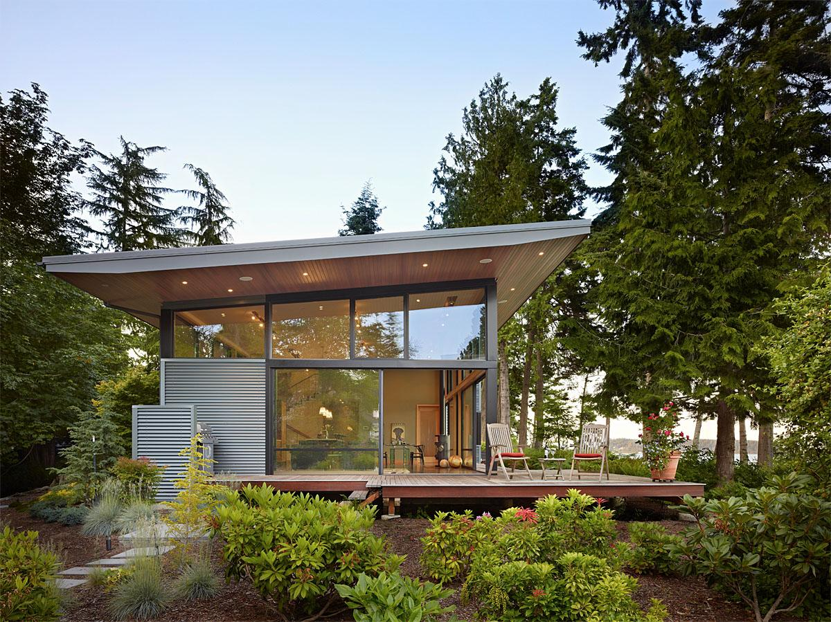 This beautiful modern home in Port Ludlow is located on a wooded waterfront property at the north end of the Hood Canal. The home was designed in a way that the indoor space\-outdoor space flow seamlessly together. The project was completed by FINNE Architects in Seattle, WA.  (Image: Port Ludlow / Porch.com)
