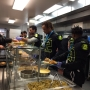 UO players donate time, work at Eugene Mission serving meals