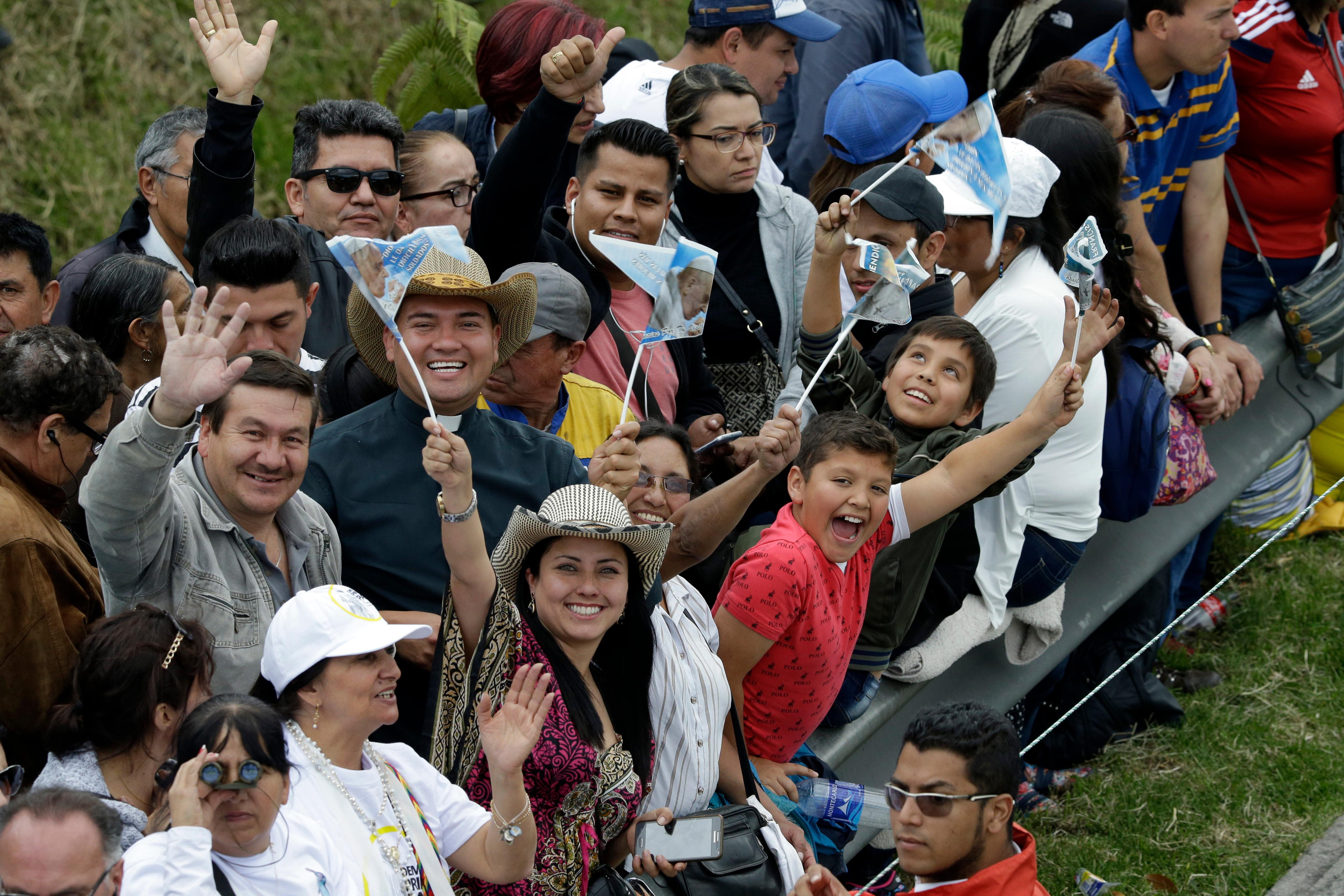 People cheer as they wait for Pope Francis to pass along the road between the airport and the Nunciatura in Bogota, Colombia, Wednesday, Sept. 6, 2017. Pope Francis has arrived in Colombia for a five-day visit. (AP Photo/Fernando Vergara)