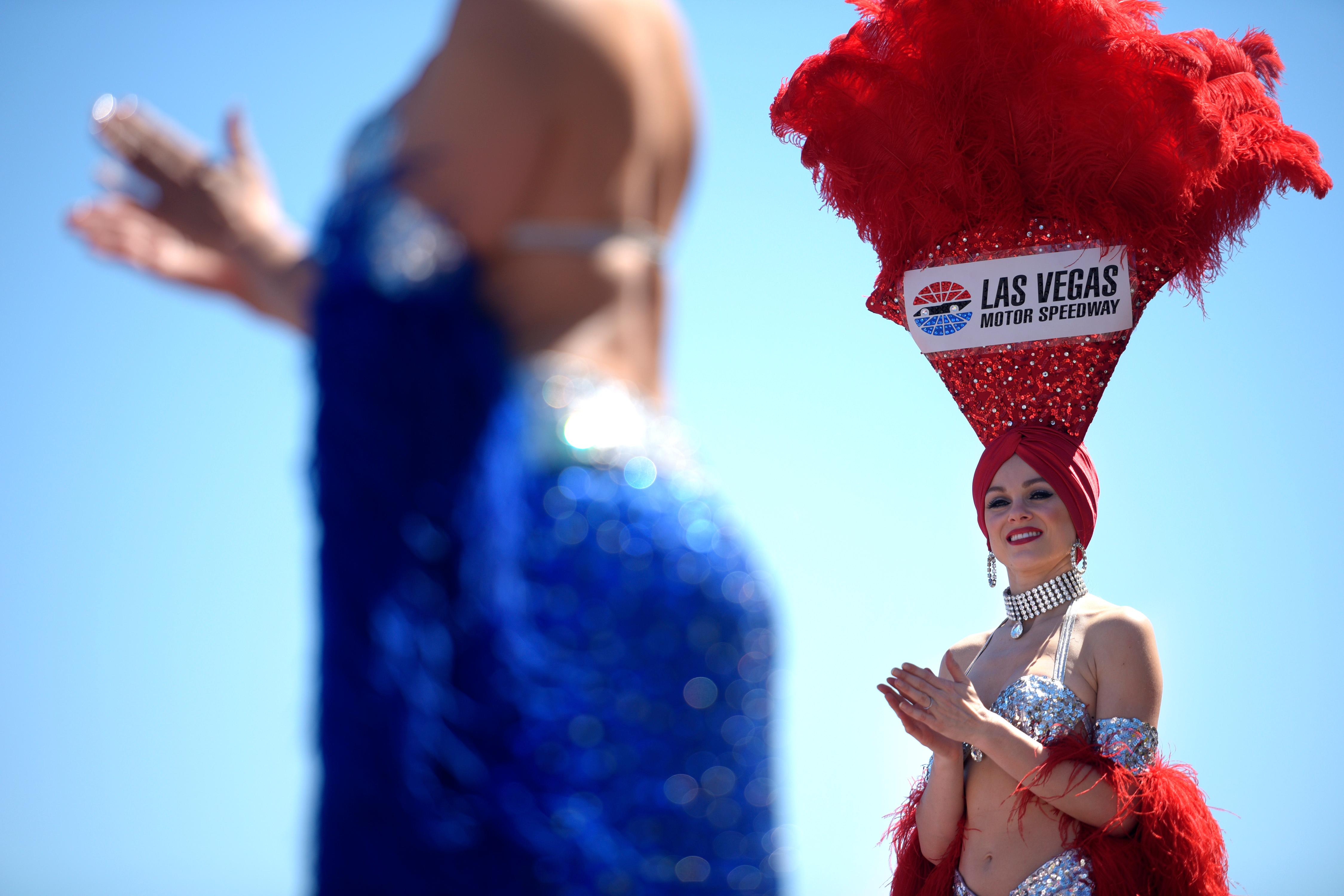 Showgirls wait for driver introductions during the NHRA DENSO Spark Plug Nationals at The Strip at the Las Vegas Motor Speedway Sunday, April 2, 2017. (Sam Morris/Las Vegas News Bureau)